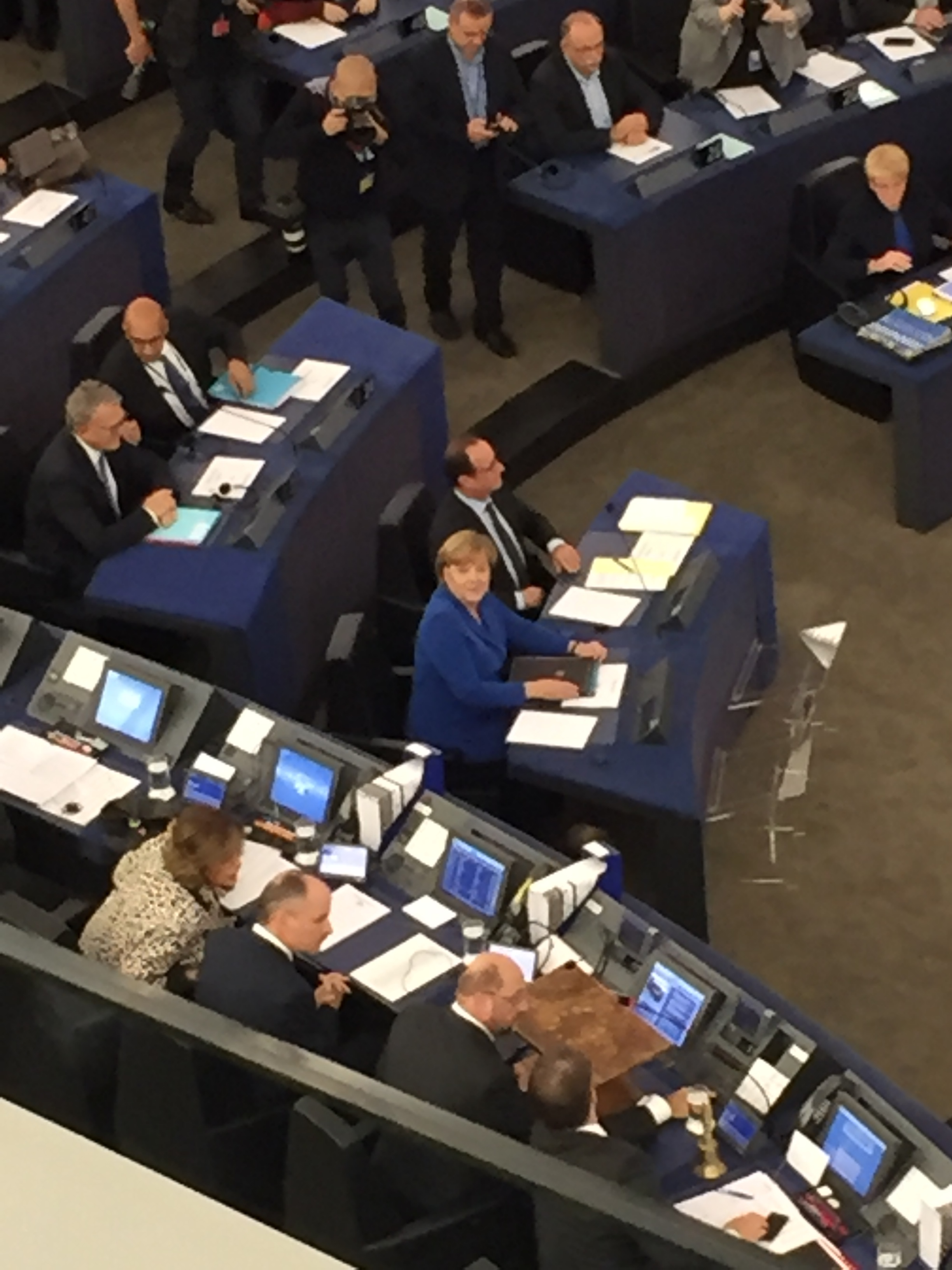 The potato quality picture I took of Chancellor Merkel staring into my soul. Also, François just chilling out, as he is wont to do.