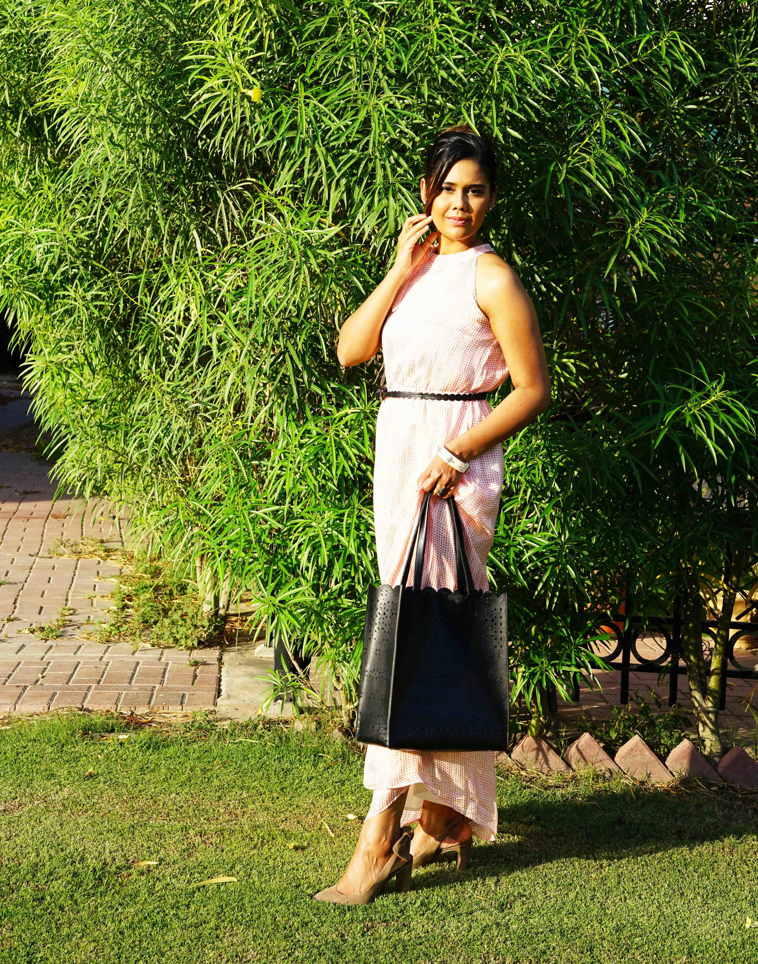 Inspired by visuals of Mumbai, a rust printed sari-silhoutte maxi dress paired WITH SUEDE HEELS, SIMPLE LEATHER BELT AND AN ELEGANT structured TOTE.. Throw in Some ethnic jewelery to break the formal code.