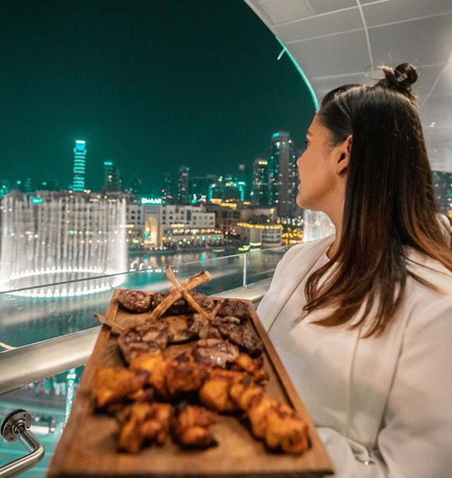 One of the best spots to soak in the views of the majestic #dubaifountains @huqqadubai