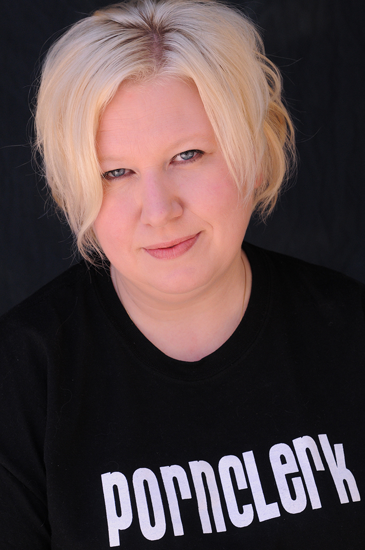 Kristine Levine is a blonde, tattooed, proudly overweight single mother working as a porn clerk in Portland, OR. In addition to regularly touring both stateside and abroad, Kristine was seen in feature stand-up documentary The Unbookables and has appeared in multiple sketches throughout each season of IFC's Portlandia. Following the 2011 Seattle International Comedy Competition, 2012 saw her perform at the South By Southwest Music Festival, throughout the month of August at Scotland's Edinburgh Festival Fringe and achieve a Guinness World Record as the first female to play 50 states in 50 days on The Biggest Tour Ever.