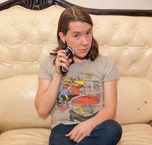 """Andy Iwancio is a transgender gal comedian from Seattle. Her comedy speaks to the trials and tribulations of being trans, and also the fun of growing boobs. She is a regular at the """"Comedy Nest"""" and a producer of the """"Five Quarters Funny"""" show at Shorty's. She has appeared at Bumbershoot, Women in Comedy NW, Intersections Festival and Seattle Trans Pride."""