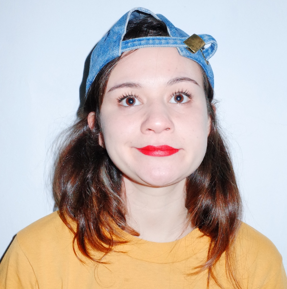 """When you first see Elena C. Hayden you're probably wondering, isn't she past her curfew? Don't be fooled by her sweet smile and fairy-like disposition, this girl is out for vengeance after getting a pair of pants in the mail with fake pockets. Elena C. Hayden is a Cuban-America stand-up comedian hailing from rainy Portland, OR. She played the lead in the short film """"Victimized"""" which was accepted into 13 international film festivals. Post college, like most millennials, Elena struggled to find a conventional job, so in 2017 she took to the road and traveled across America via train. Her adventures can be found on elenaescapes.wordpress.com."""
