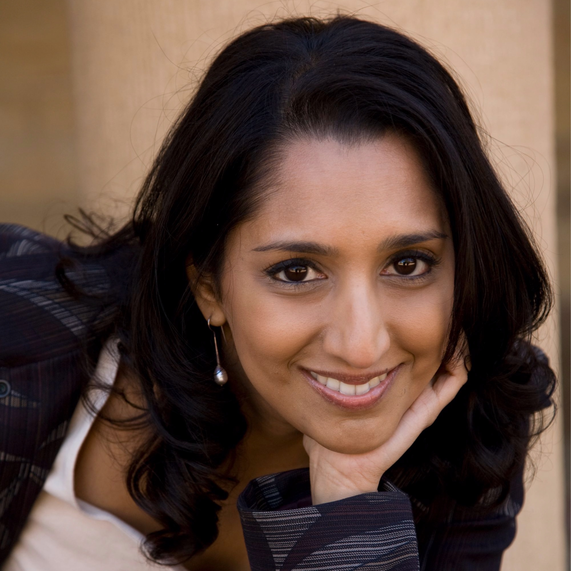 """Dhaya Lakshminarayanan is the 2016 winner of the Liz Carpenter Political Humor Award (previously awarded to Samantha Bee, Wanda Sykes and satirist/humorist Mark Russell) presented by the National Women's Political Caucus. Comedy Central Asia crowned her the Grand Prize Winner of """"The Ultimate Comedy Challenge"""" filmed in Singapore. She is the sole subject of the documentary """"NerdCool"""" which premiered at the LA Comedy Festival in 2018  KQED named her one of the twenty """"Women to Watch"""" a series celebrating women artists, creatives and makers in the San Francisco Bay Area who are pushing boundaries in 2016. She was named one of """"The Bay Area's 11 Best Standup Comedians"""" in 2016 and """"13 San Francisco Standup Comedians to Go See Now"""" in 2018 by SFist. The SF Weekly named her one of the """"16 Bay Area performers to watch in 2016."""" The San Francisco Bay Guardian named her Best Comedian 2013 in the """"Best of the Bay"""" Readers' Poll.  She has opened/featured for or worked with the following: Janeane Garofalo, Marc Maron, Greg Behrendt, Jello Biafra, the late Dick Gregory, Anthony Jeselnik, Maz Jobrani, and Greg Proops. Dhaya introduced former Vice President Al Gore at an event. He then laughed onstage at her joke, so technically she once opened for Al Gore. She has performed internationally in Shanghai, China; Kuala Lumpur Malaysia, and Singapore. In the US she has been an invited performer at Bridgetown Comedy Festival (Portland, OR), San Francisco Sketchfest, the Boston Comedy Festival (semifinalist), the Limestone Comedy Festival (Bloomington, IN) and Laugh Your Asheville Off (Asheville, NC).  Dhaya is also a TV host and storyteller. She hosted the premier year of the Emmy award-winning series High School Quiz Show on PBS's WGBH. She is a frequent comedic storyteller on NPR's Snap Judgment and has appeared live in Austin on The Risk podcast. She is currently the host of San Francisco's monthly Moth StorySLAM after winning a Moth StorySLAM and competing in the GrandSLAM."""