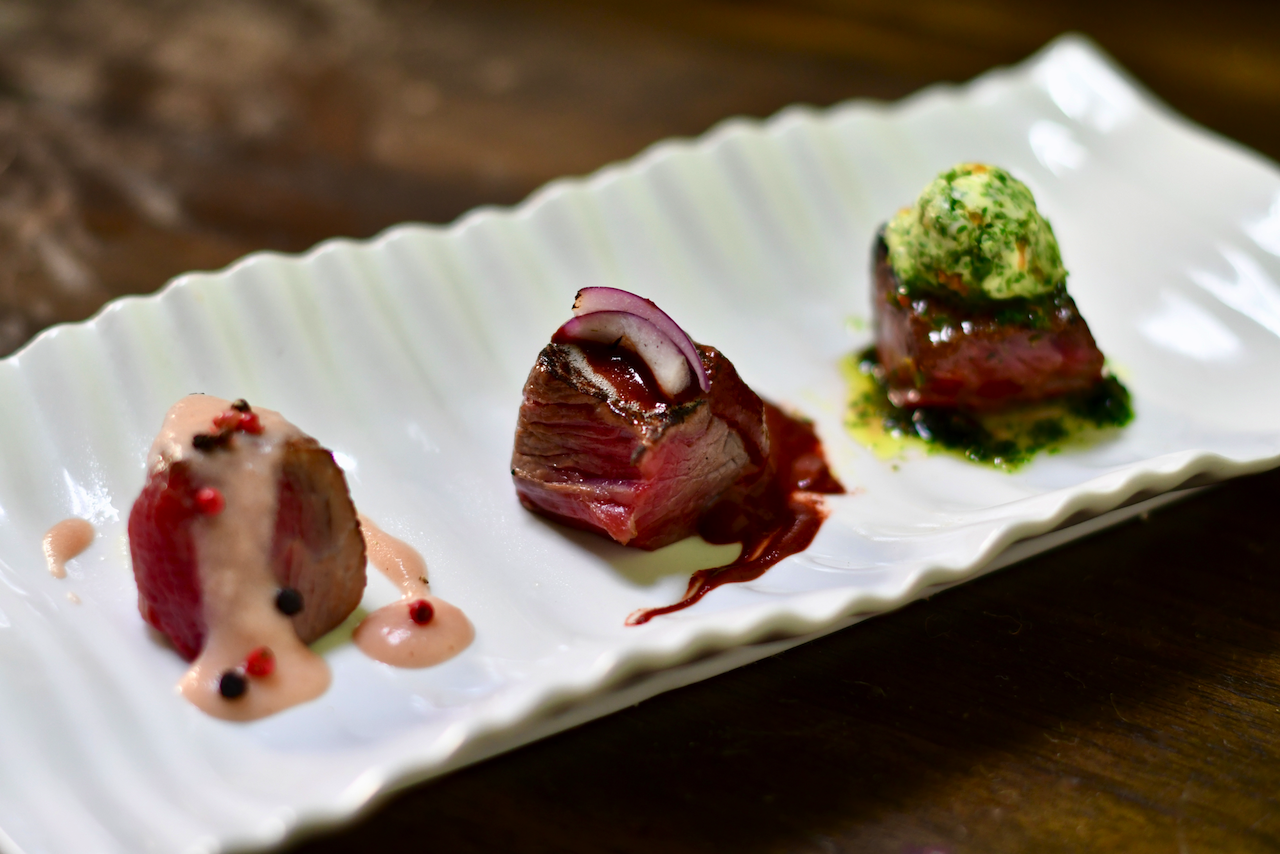 Steak Flight: Pink Peppercorn Sauce/Dark Chocolate-Chili Sauce/Chimichurri Butter