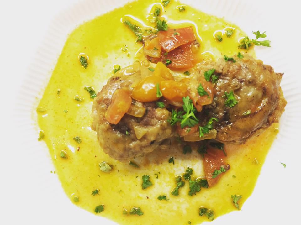 Mafroum (Stuffed artichokes with lamb/ saffron infused tomato sauce)