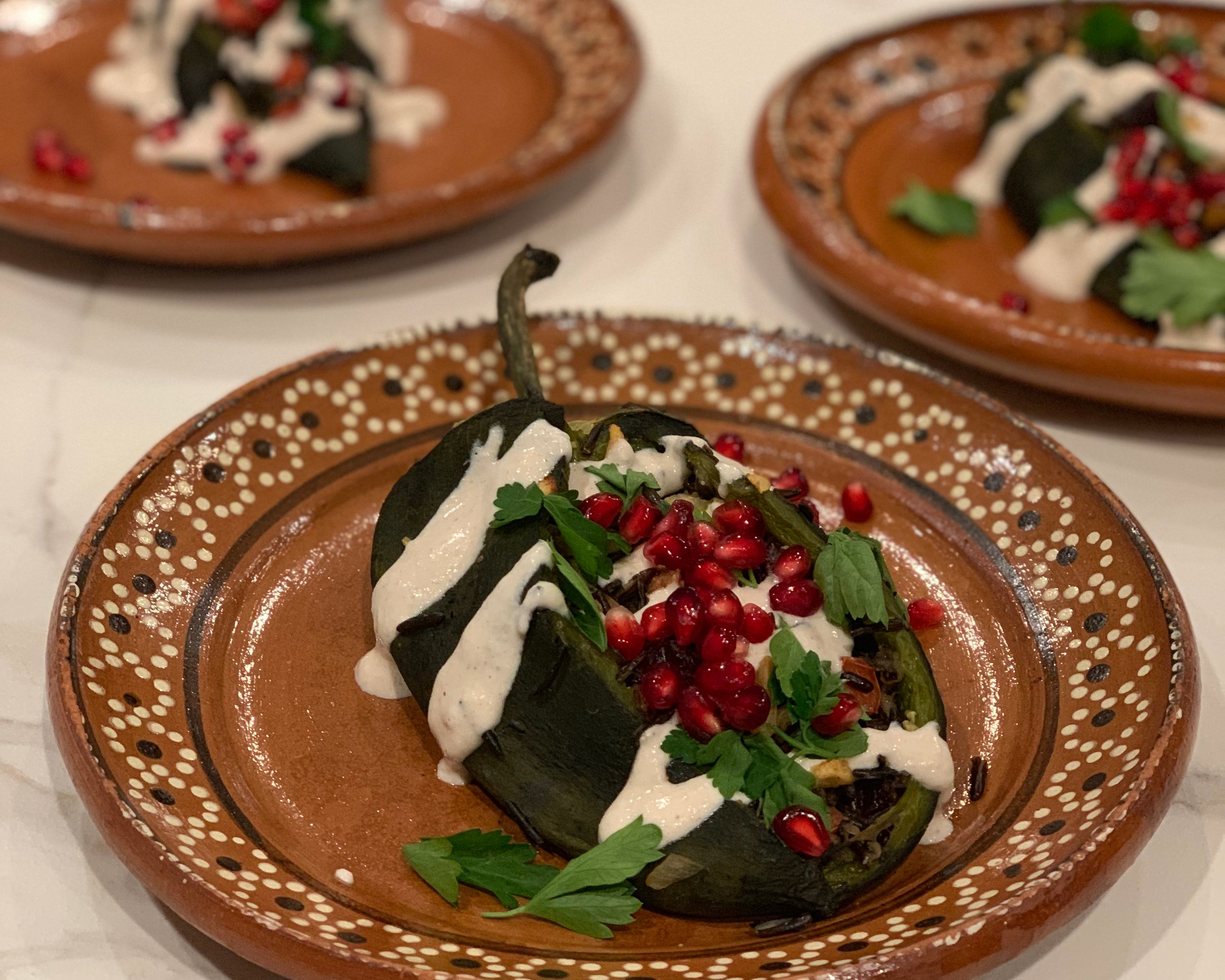 "Wild Rice ""Picadillo""-stuffed Poblano Chiles/Walnut Cream/Pomegranate/Cilantro"