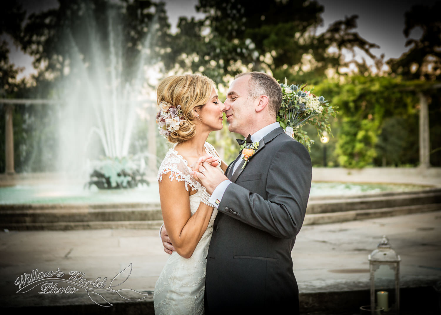 ...Without missing a chance at catching the sunset and fountain behind their gorgeous first kiss as husband and wife.