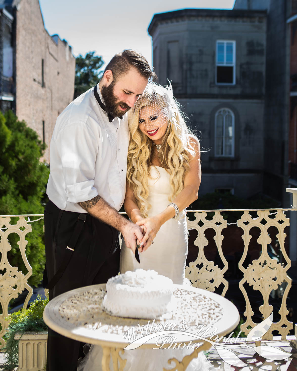 Cutting the cake on the lovely (and spacious) balcony of the Cornstalk Hotel...