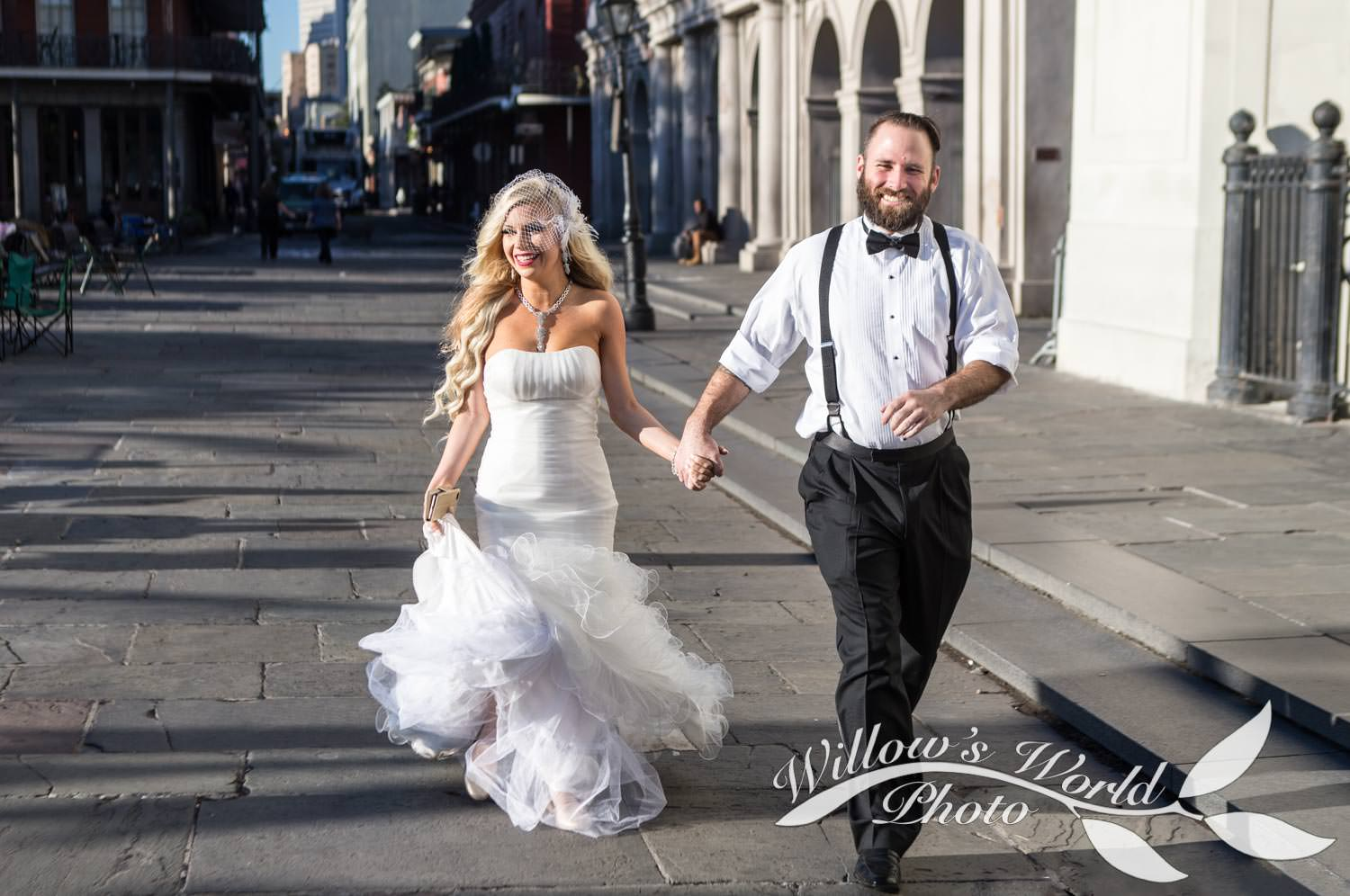 Lo and Major walk hand in hand across Jackson Square...