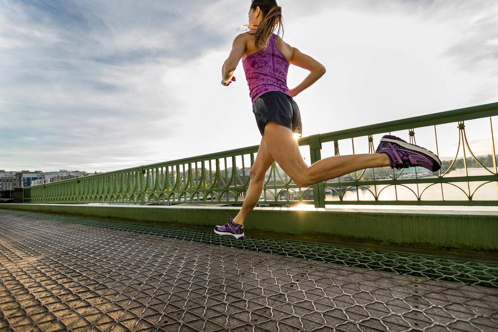 Photo by Stephen Matera. Dr. Elena Zinkov running for Topo Athletics.