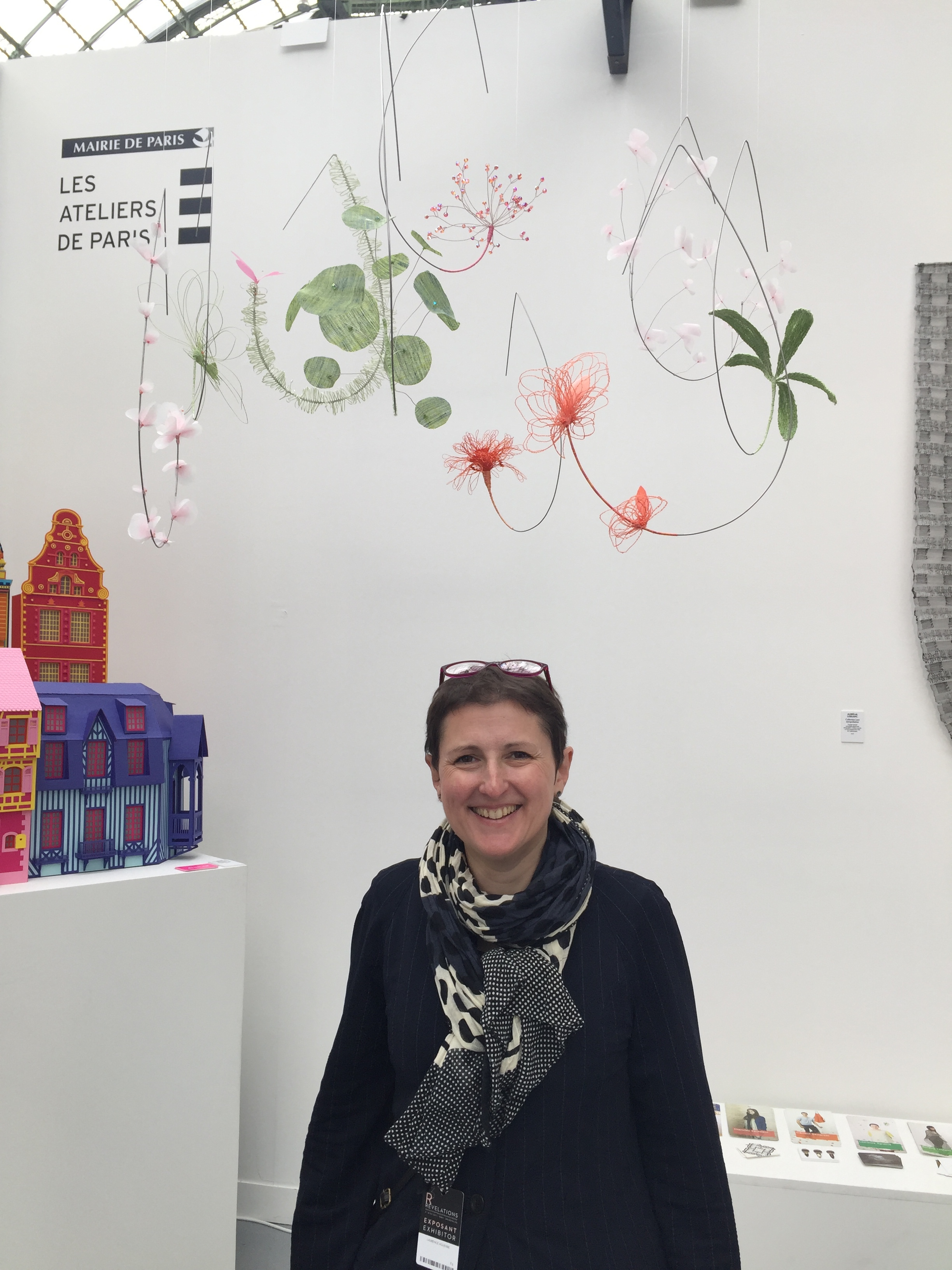 Laurence at the Ateliers de Paris booth at the Grand Palais biennial exhibition or French craftsmanship with her floral mobile