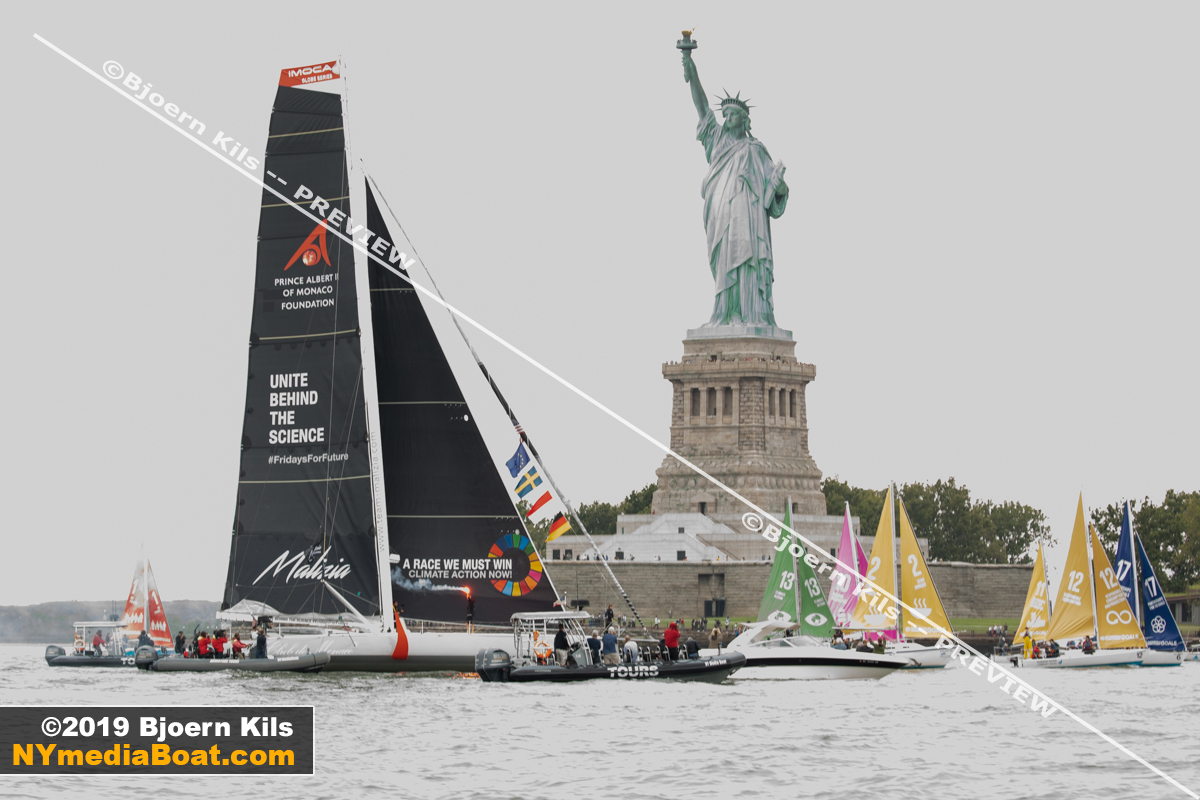 The United Nations arranged a sailboat flotilla to welcome Greta with colorful sails.