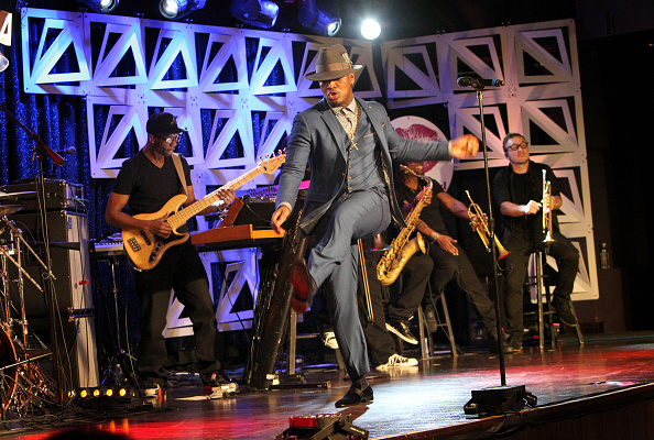 Ne-yo performing in an ensemble put together by the talented Apuje Kalu