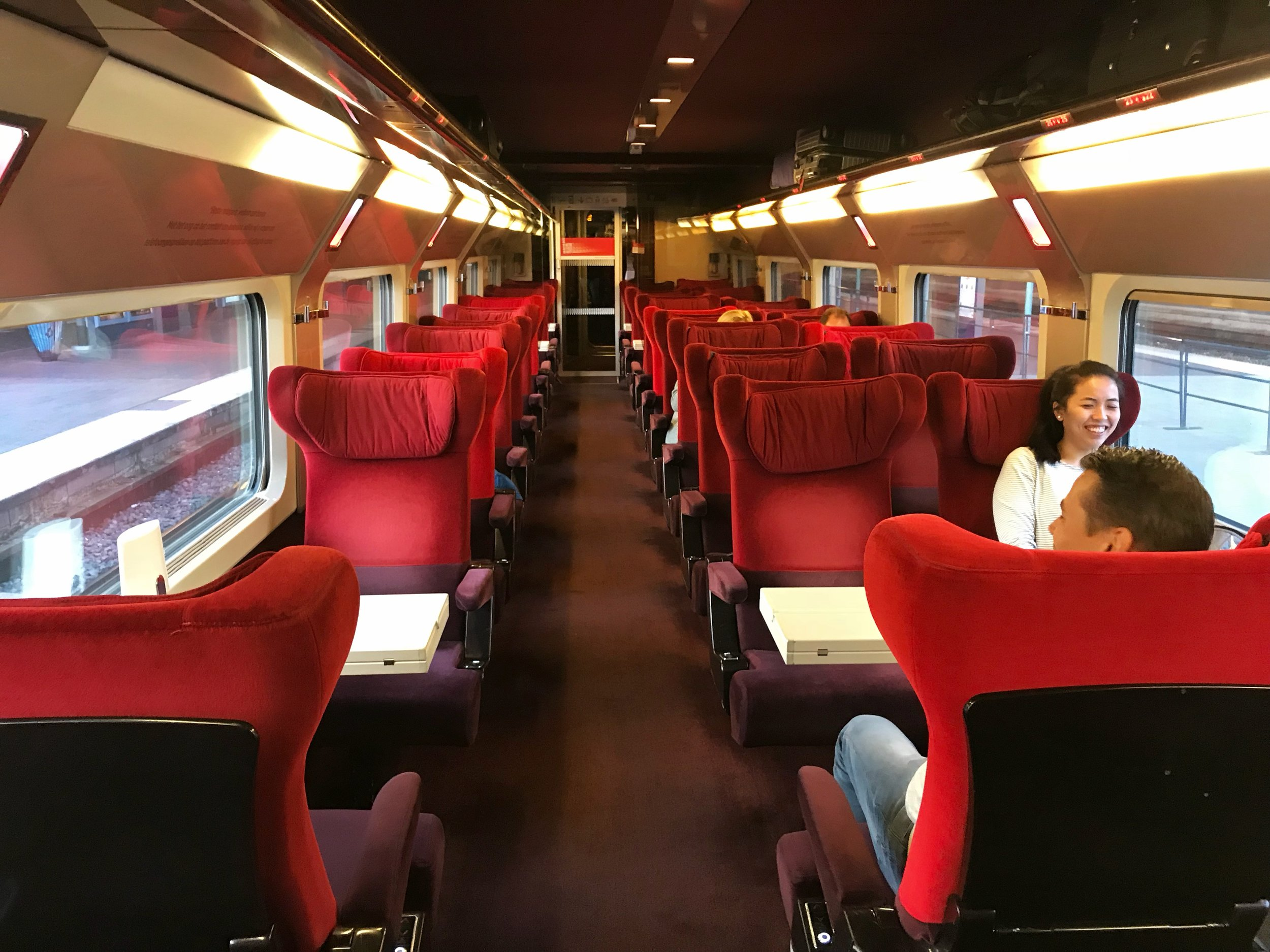 First Class cabin on Thalys train. Includes meals, wifi, power outlets as well.