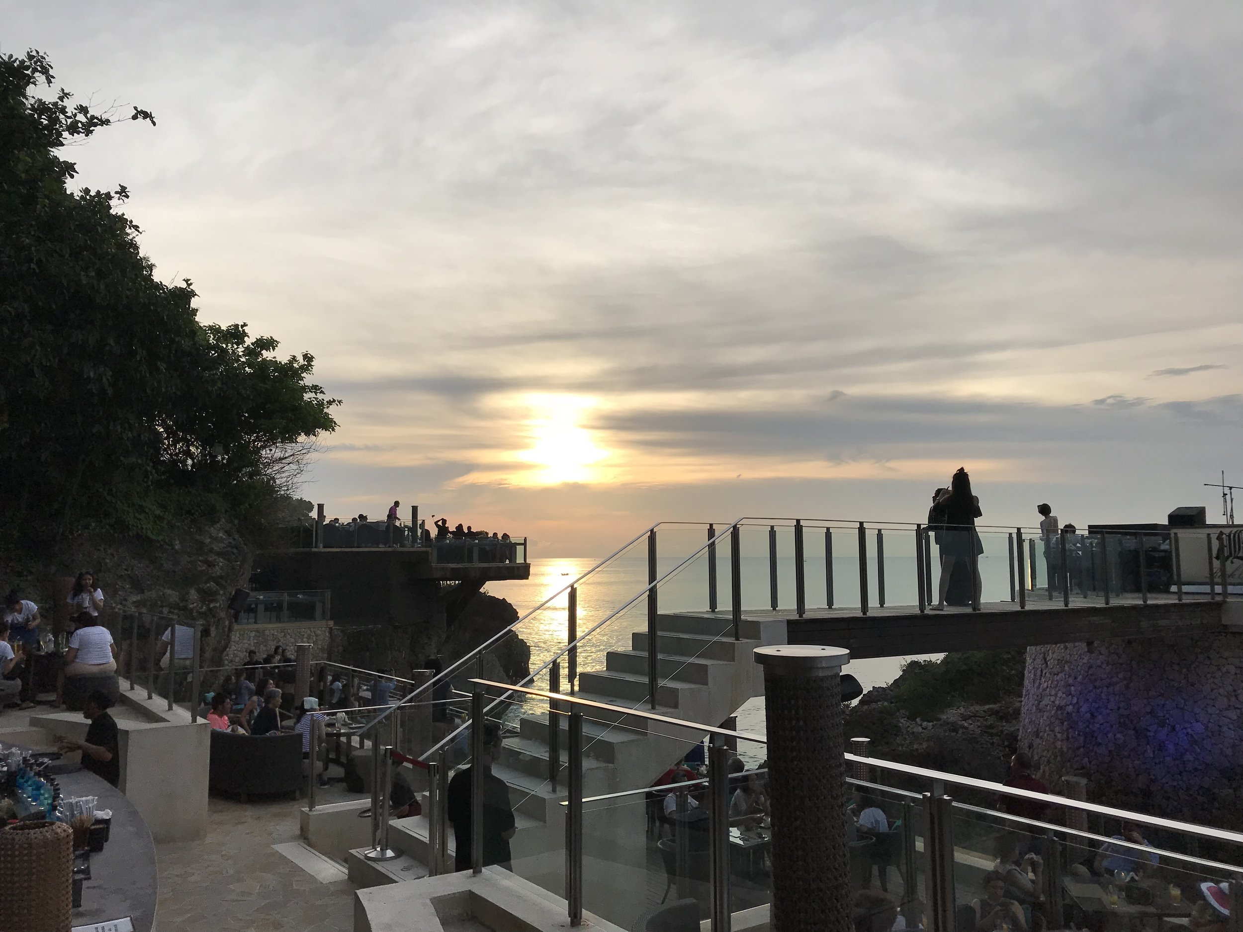 Waiting for the sun to set at the Rock Bar in Bali. make sure you ask for a seat with a view.
