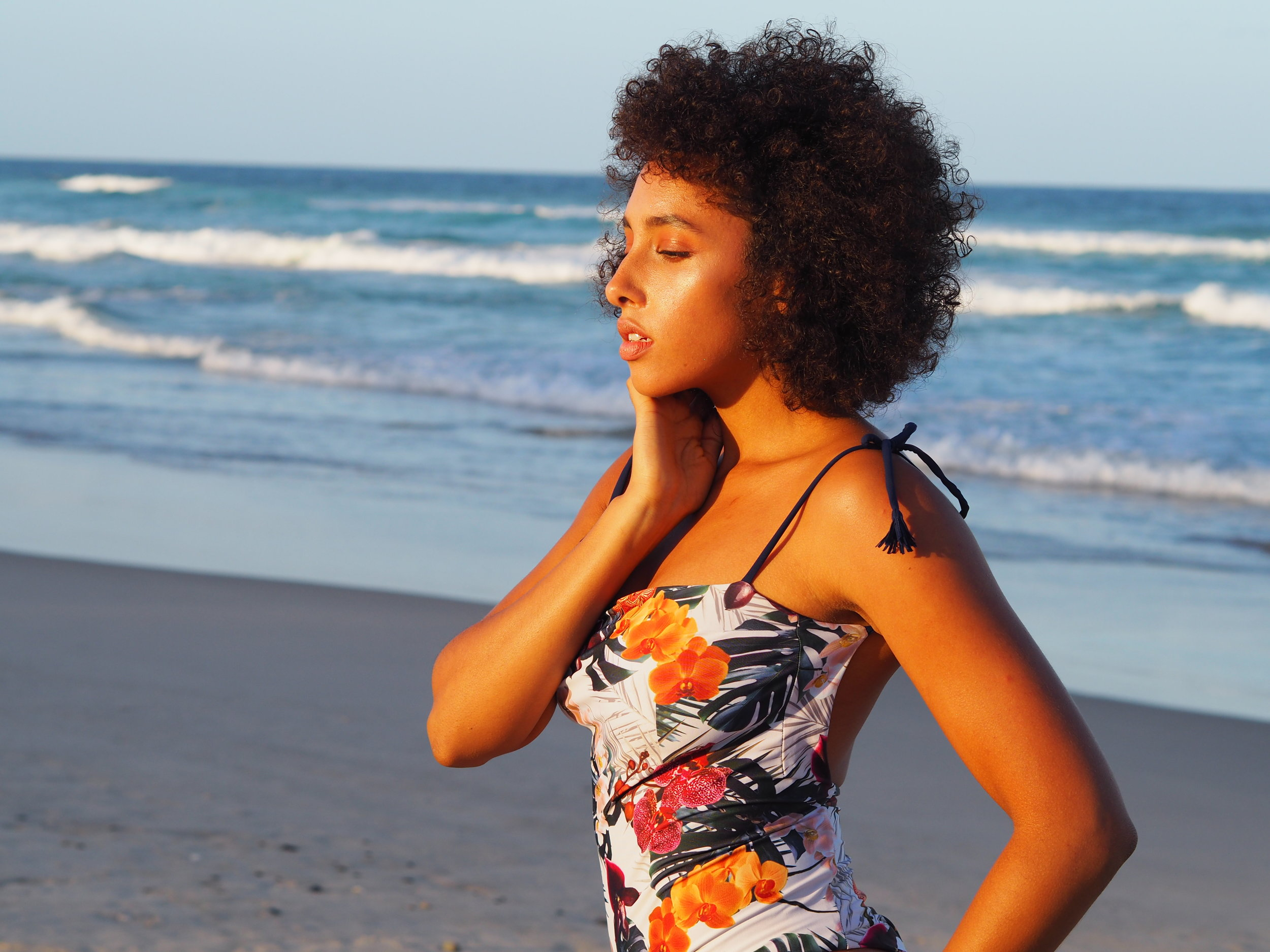 Danielle Sams with the  Sandman reversible onepiece in Orchid print  at Byron Bay
