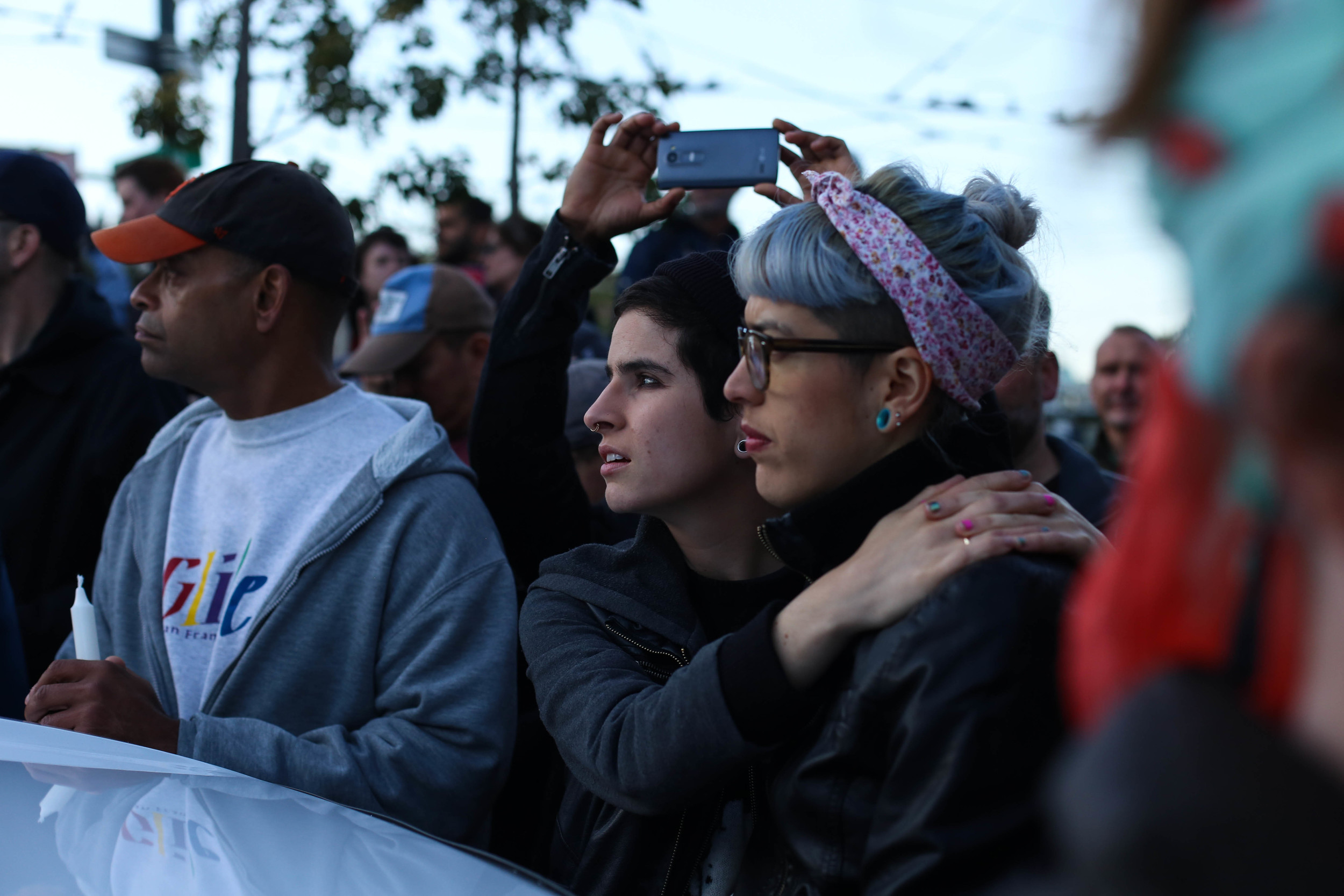 Laura Ceron & Juliana Delgado look towards the speakers during a vigil in Harvey Milk Plaza to remember the victims of the Orlando shooting.