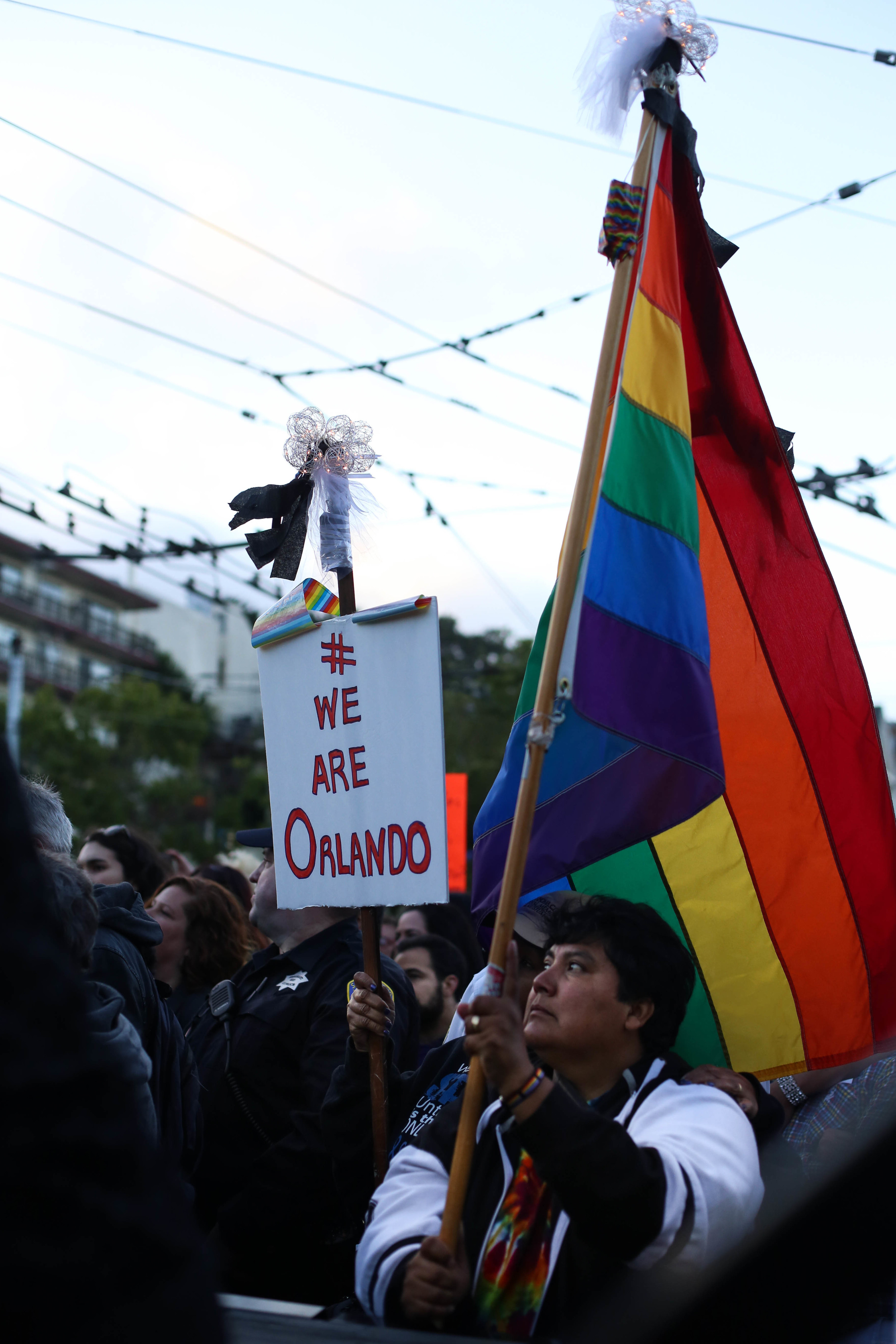 Laura Carnosa (Marin, CA) holds up a rainbow flag during a vigil in Harvey Milk Plaza to remember the victims of the Orlando shooting.