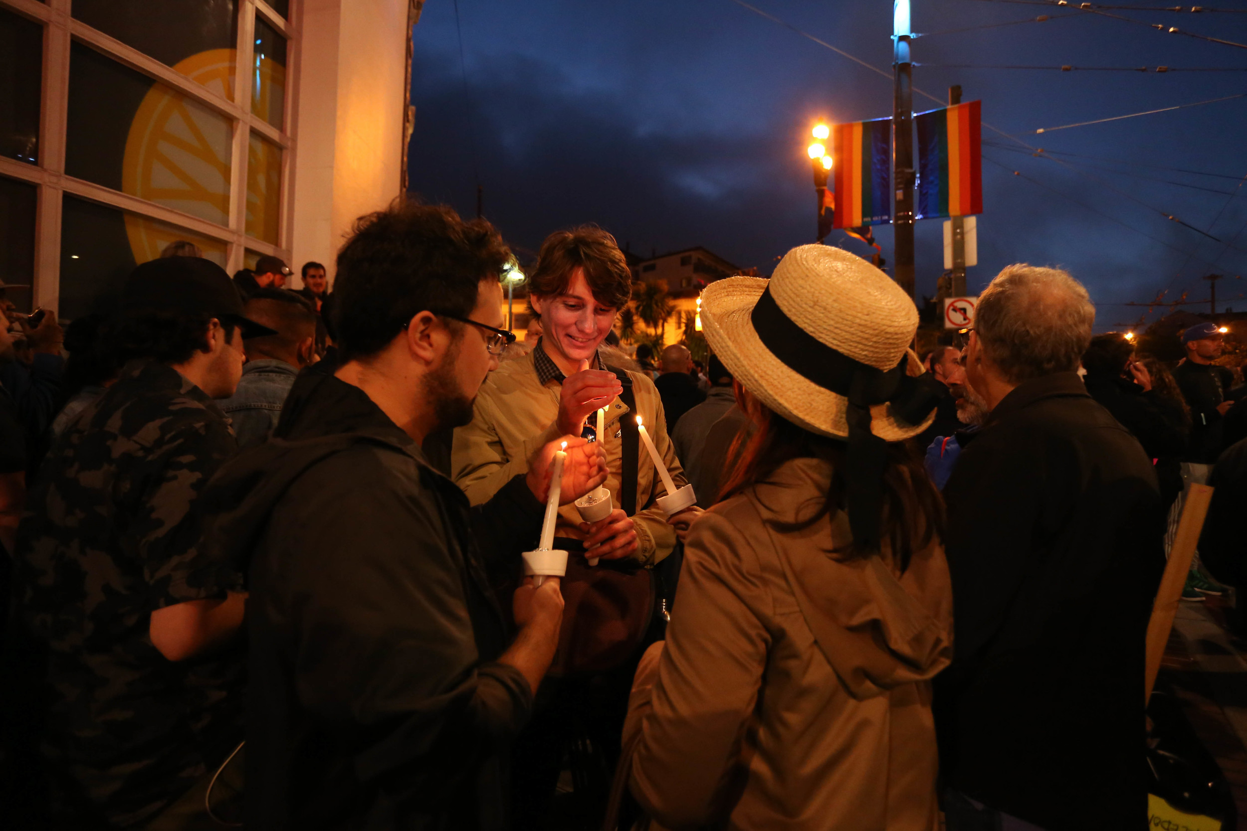 Eric Easley lights a candle during a vigil in Harvey Milk Plaza to remember the victims of the Orlando shooting.