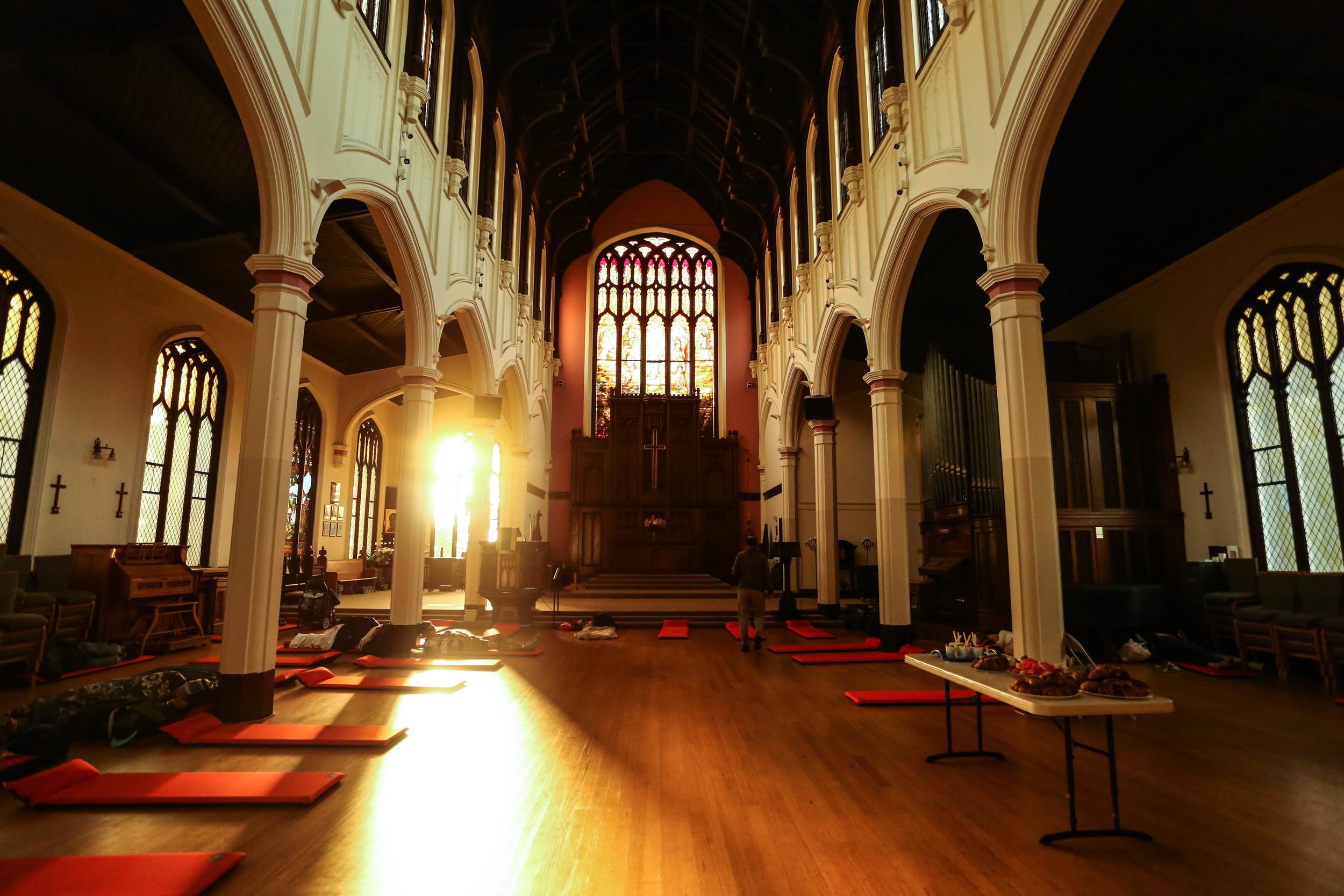 Orange mats line the floor at the Gubbio Project held in St. John the Evangelist Episcopal Church.