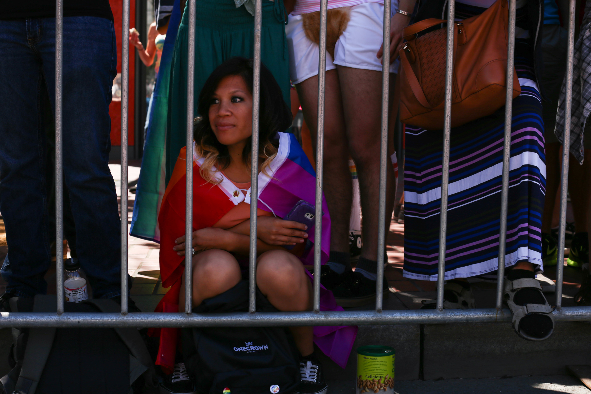 Emerald Rubio (San Jose, Cali.) watches the parade with her mother for the first time as thousands gathered to celebrate Pride in San Francisco, Cali. Sunday, June 26, 2016.