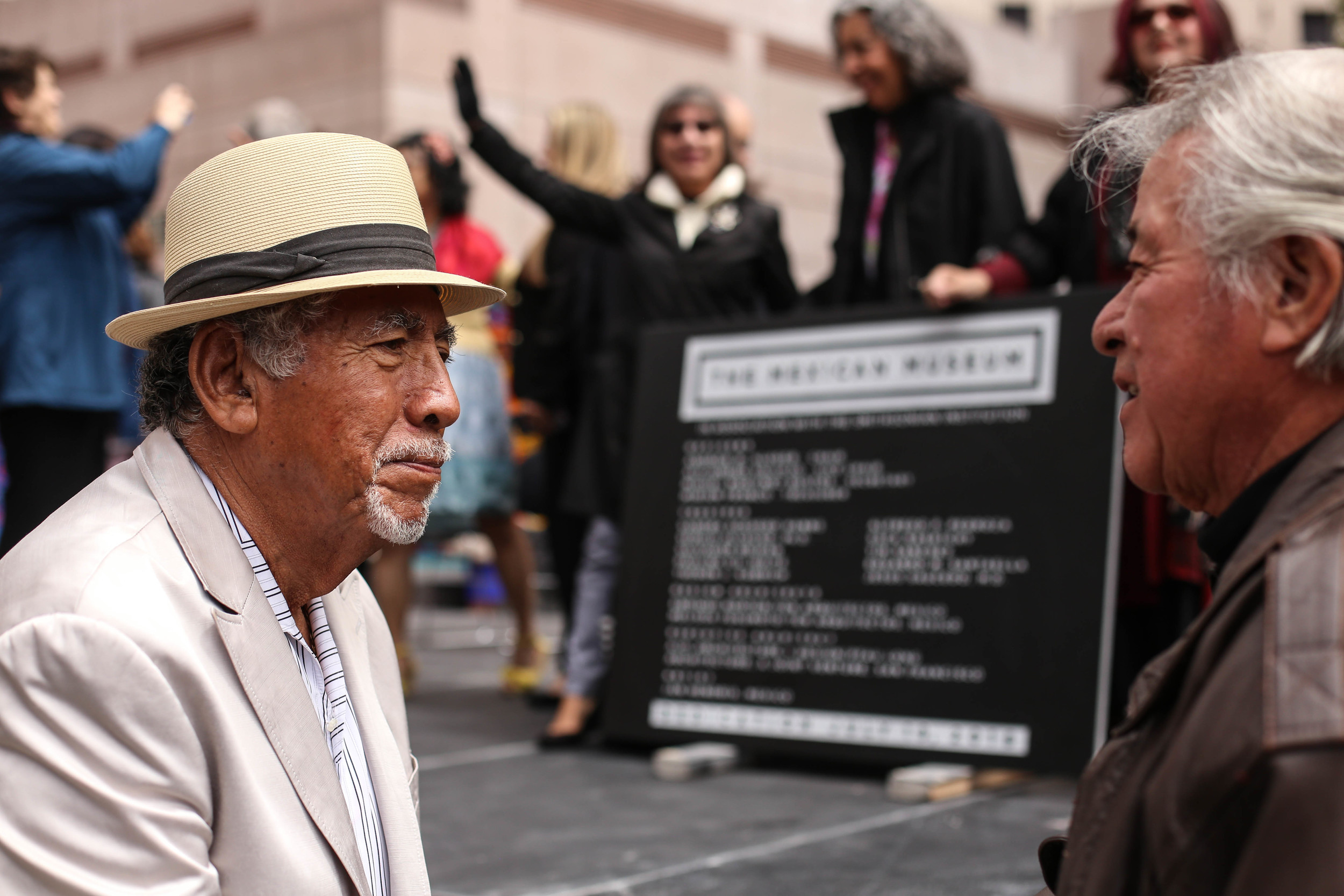 Alcario Castellano (San Jose) and Gil Hernandez (San Jose) at the dedication ceremony for The Mexican Museum in San Francisco, California. Tuesday, July 19, 2016. Jessica Webb