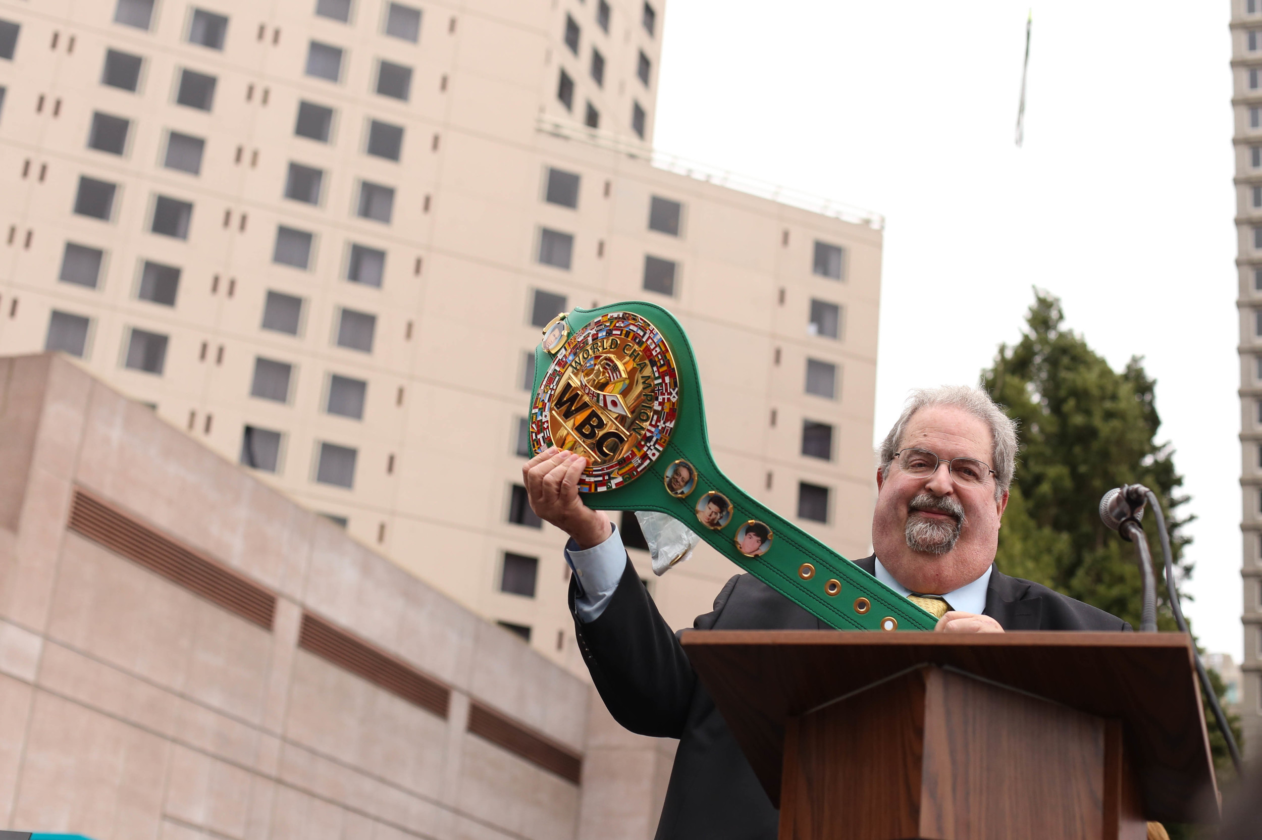 Andrew Kluger, The Mexican Museum Board Chairman, with the WBC title belt at the dedication ceremony for The Mexican Museum in San Francisco, California. Tuesday, July 19, 2016. Jessica Webb