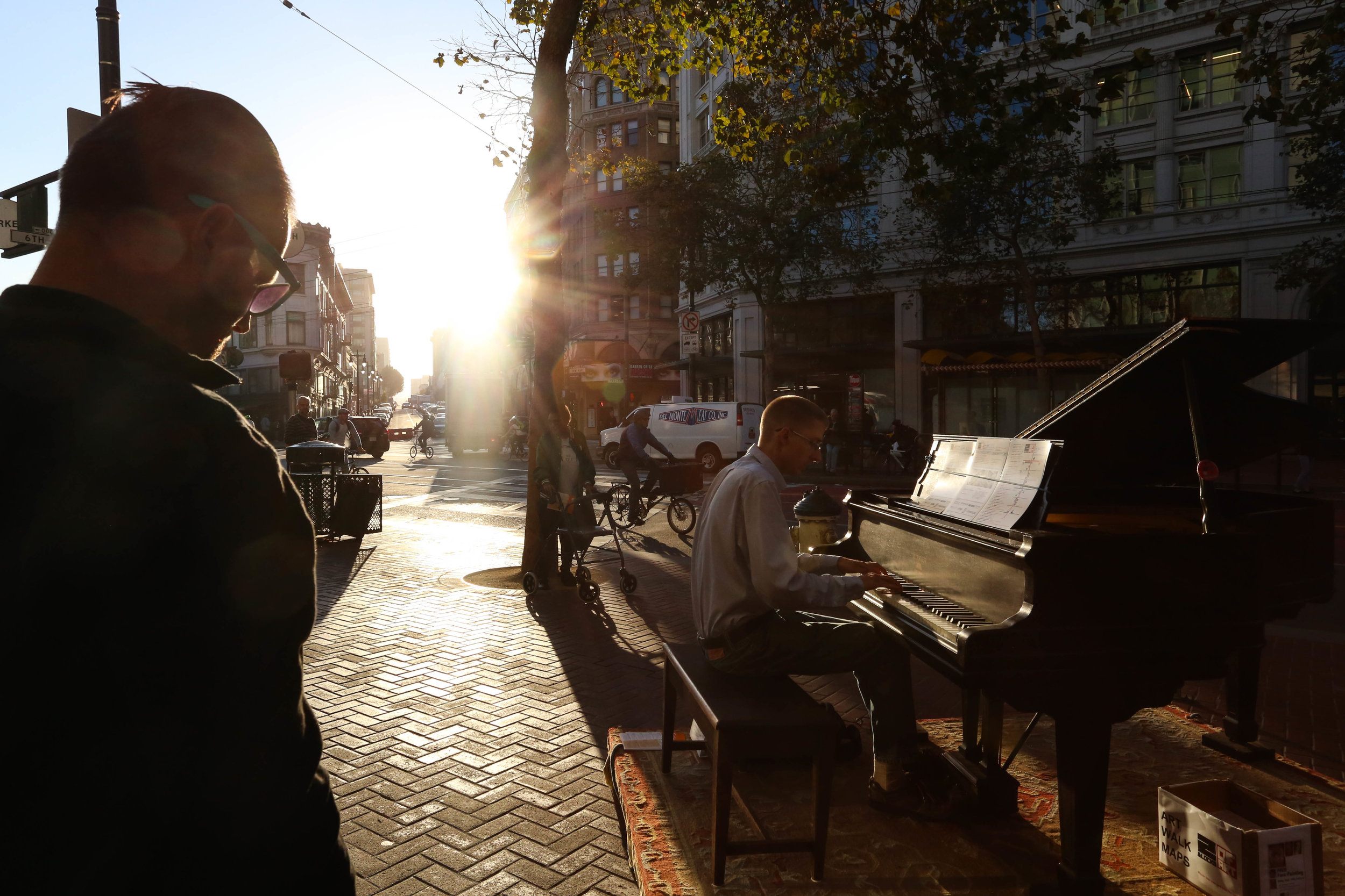 2 Blocks of Art walk begins at Market and Sixth Street with Andrew Barnes Jamieson playing for the Center for New Music. His performance attracts audience members on their way home from work, starting their Friday night and locals. Friday, September 16, 2016.Mid-Market News