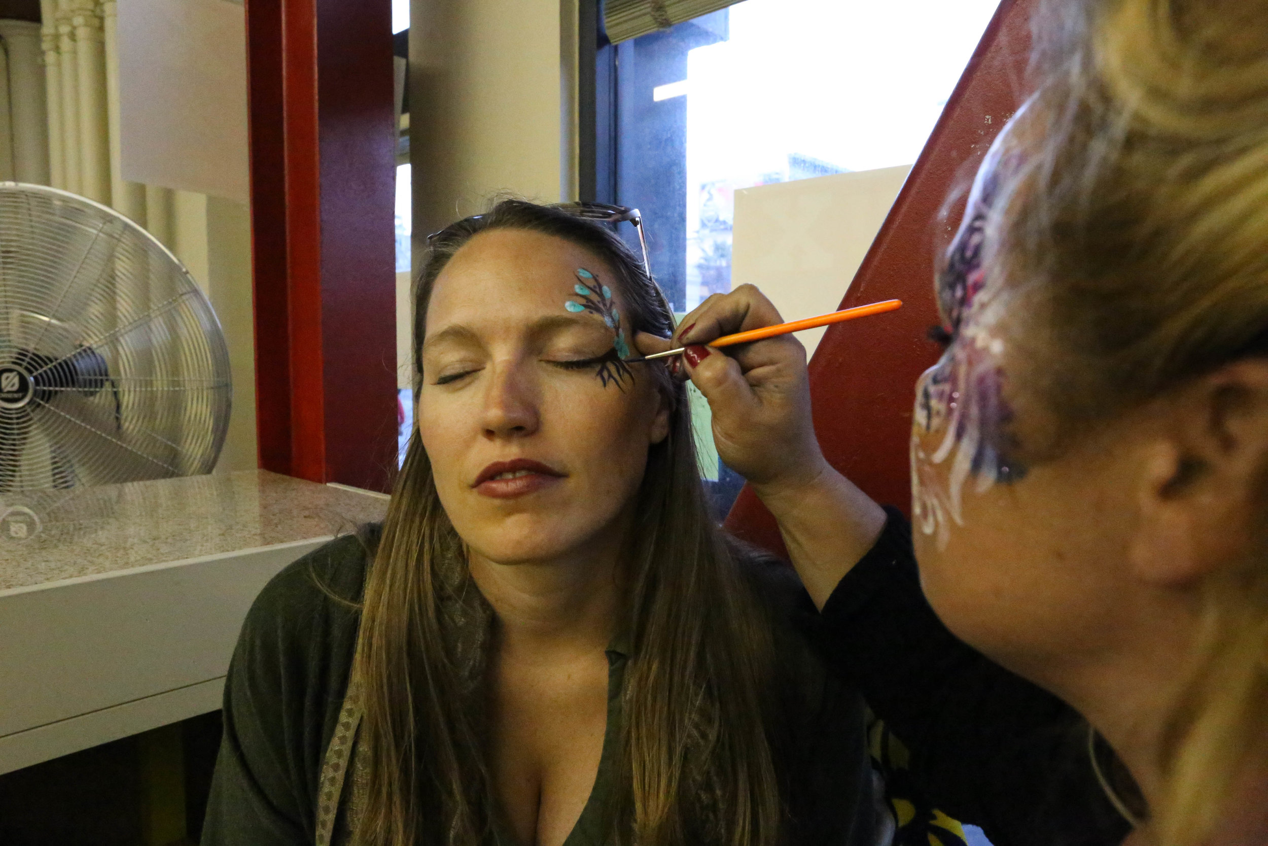 Tara Bush, Oakland California, gets her face painted at the 2 Blocks of Art walk by Jackie York of Make-up Your Mind.Friday, September 16, 2016.Mid-Market News