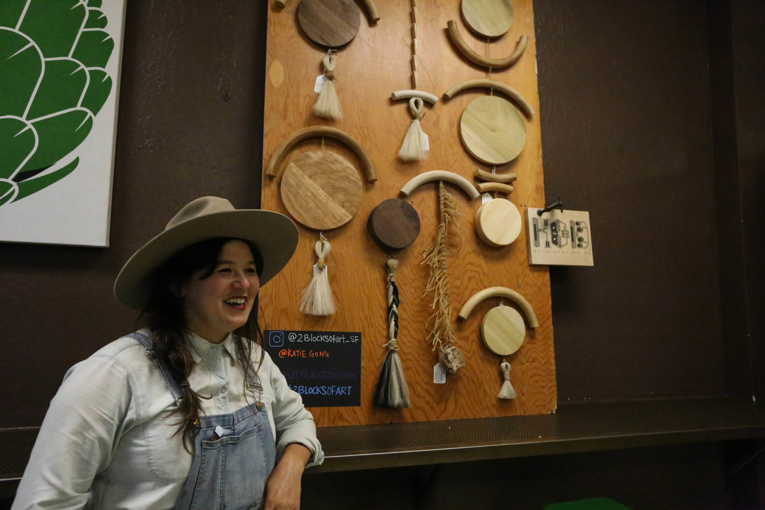 Katie Gong stands in front of her moon wall sculptures at Split Pea Seduction for the 2 Blocks of Art walk, while she talks about how she has been making art and installations since she was a little girl.Friday, September 16, 2016.Mid-Market News