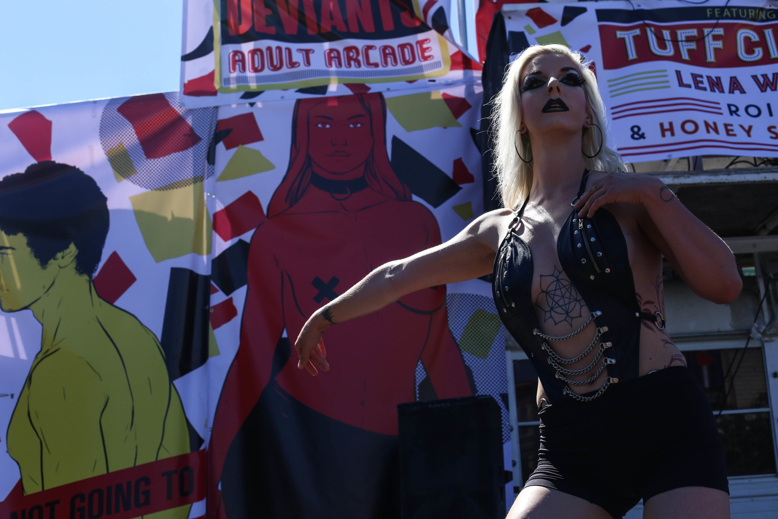 Dancers greeted people entering the Folsom Street Fair where hundreds gathered for the festivities, San Francisco, California, Sunday, Sept. 25, 2016. (Jessica Webb)