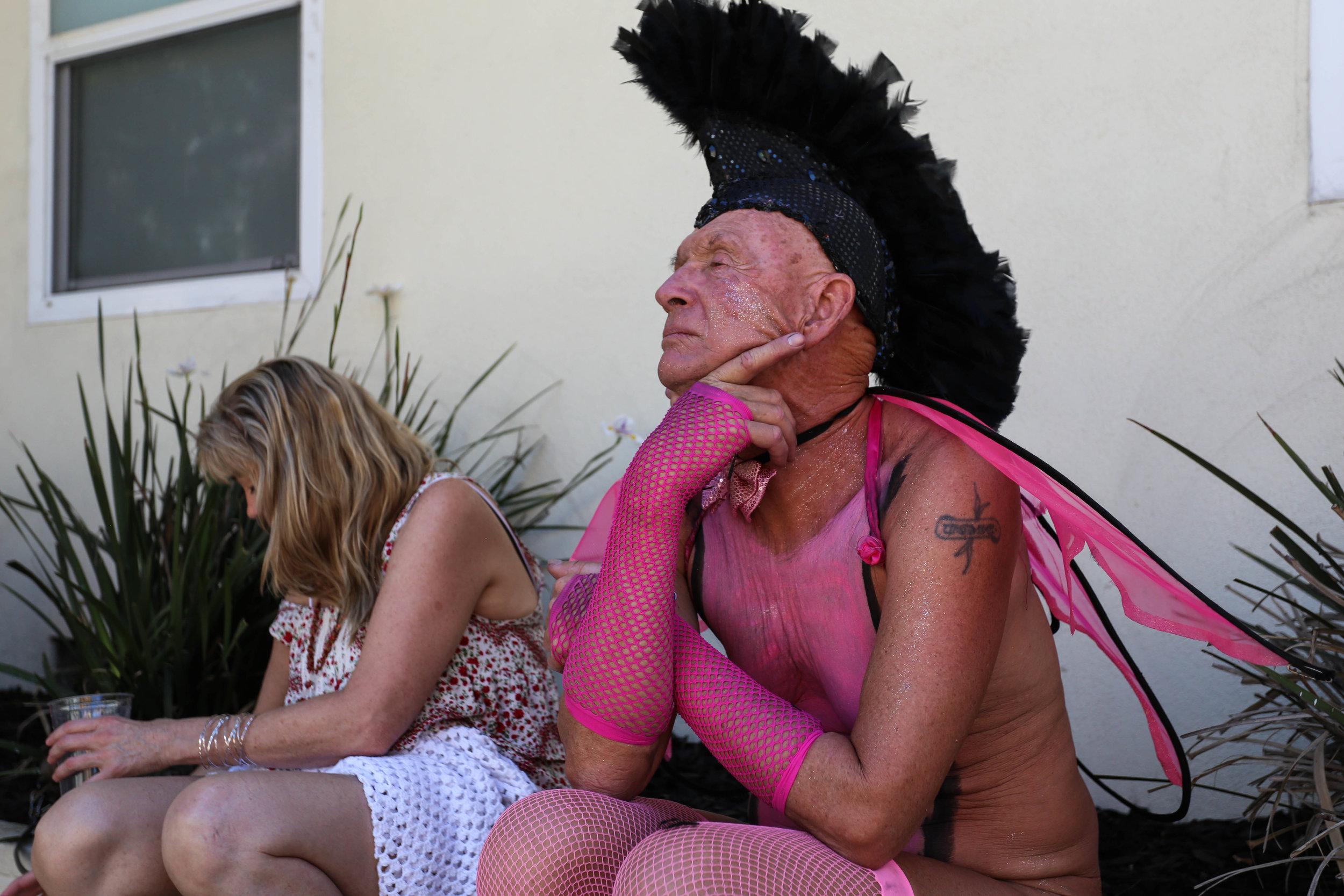 Max Schwab enjoying the shade at the Folsom Street Fair where hundreds gathered for the festivities, San Francisco, California, Sunday, Sept. 25, 2016. (Jessica Webb)