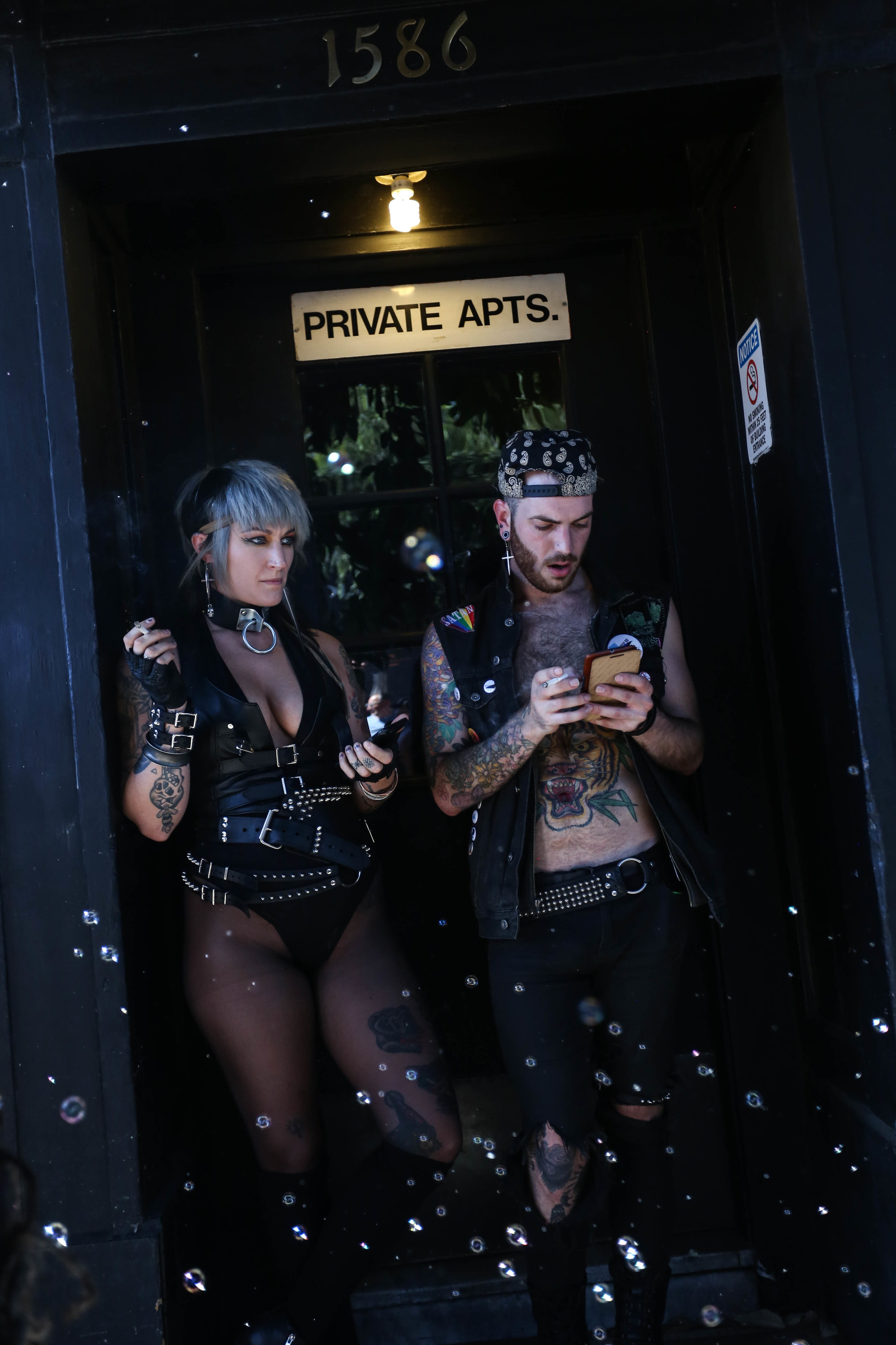 Chelsea Thebeau & Michael Flicker grab some shade at the Folsom Street Fair where hundreds gathered for the festivities, San Francisco, California, Sunday, Sept. 25, 2016. (Jessica Webb)