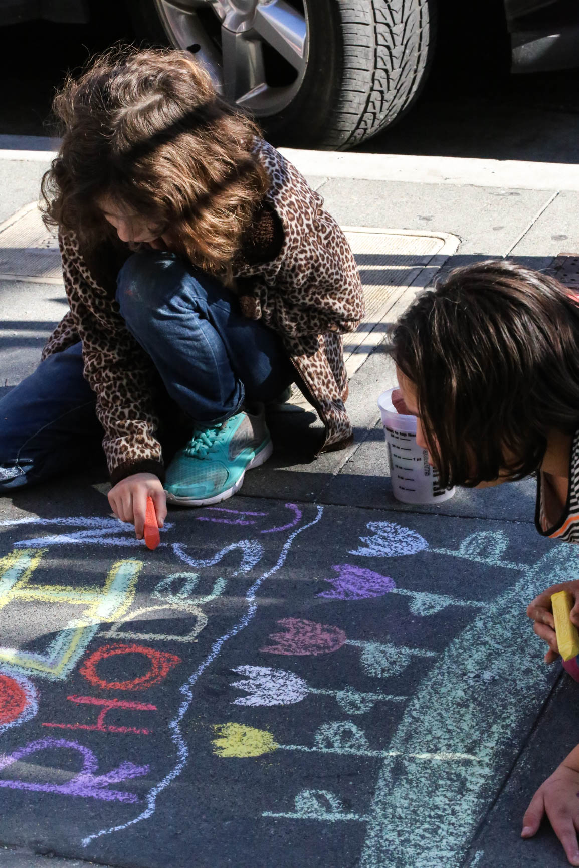 Emily Clayson (11) & Paola Fonseca (10), students at the Harvey Milk Civil Rights Academy, INSCRIBE the names of the men and women who died of AIDS. Thursday, December 1, 2016, San Francisco, California (Jessica Webb).