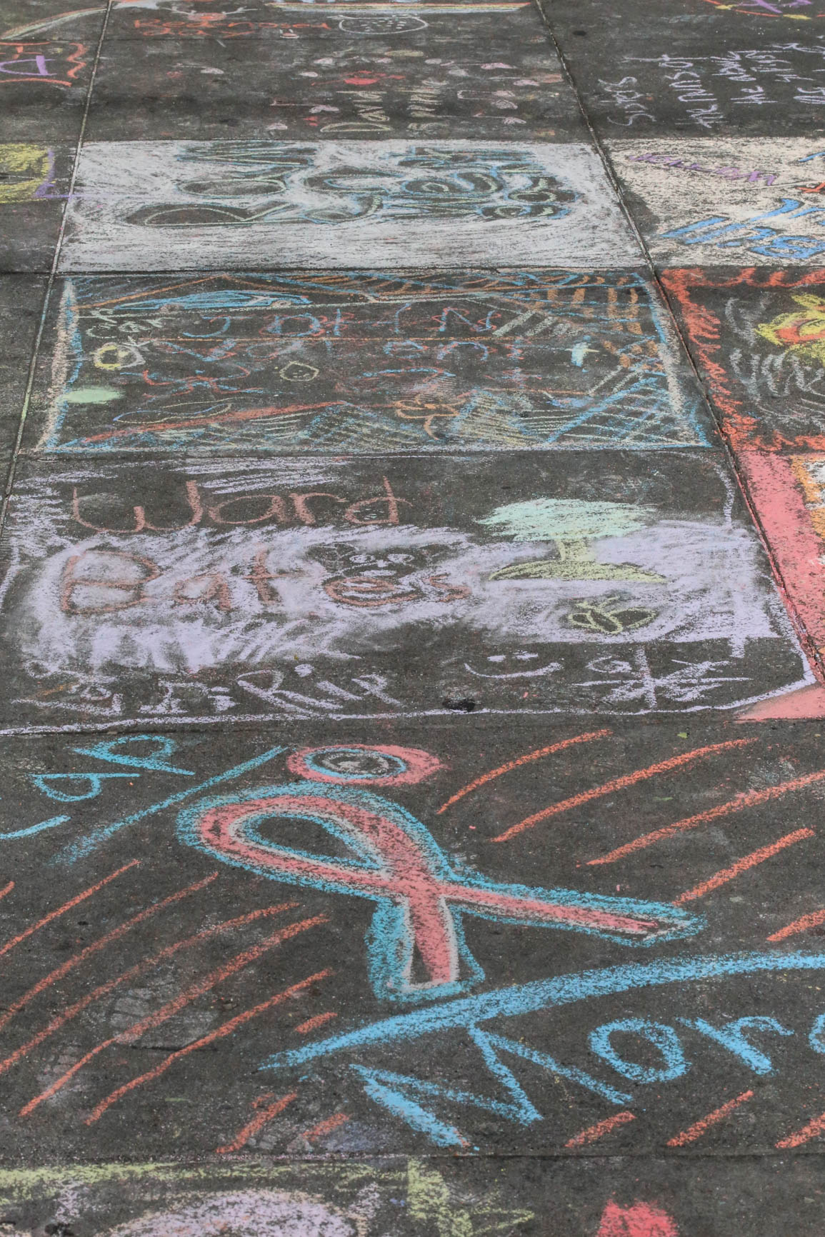 Sidewalk drawings from INSCRIBE where The Castro community gathered to honor the men and women who died of AIDS. Thursday, December 1, 2016, San Francisco, California (Jessica Webb).