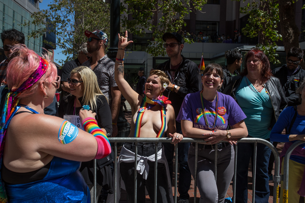 Parade watchers rock out to the live music that the California Bluegrass Association at the 2017 San Francisco Pride Parade on Sunday, June 26, 2017, San Francisco, California (Jessica Webb)