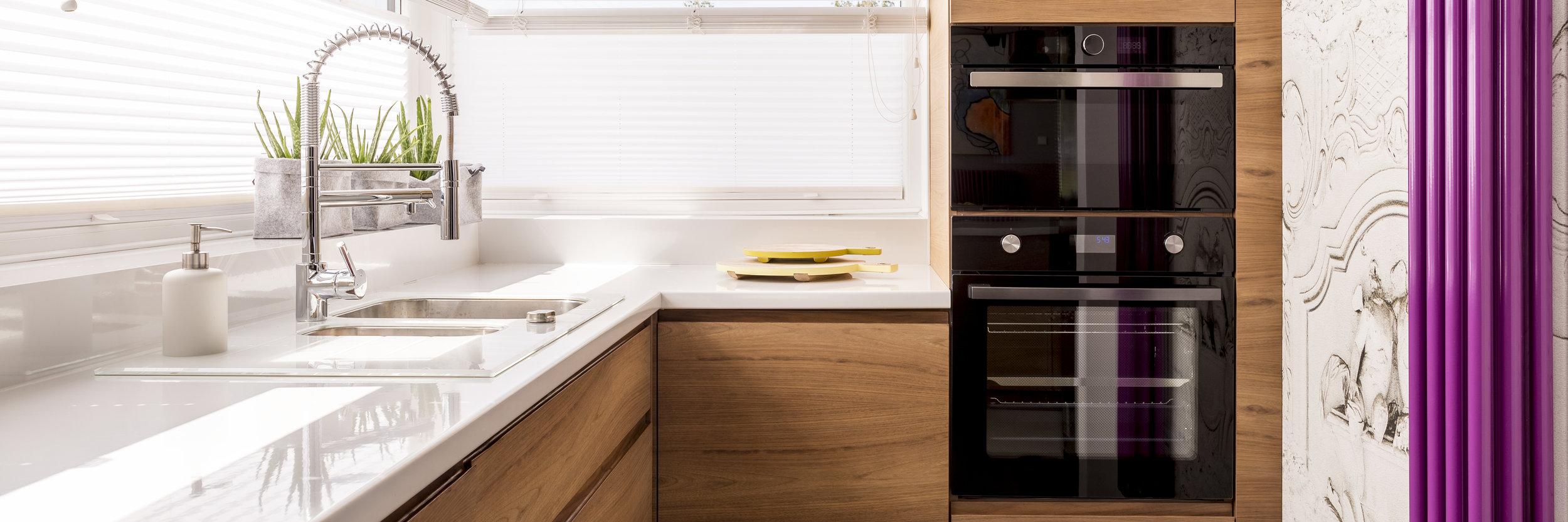 Kitchen with white glossy countertop.jpeg