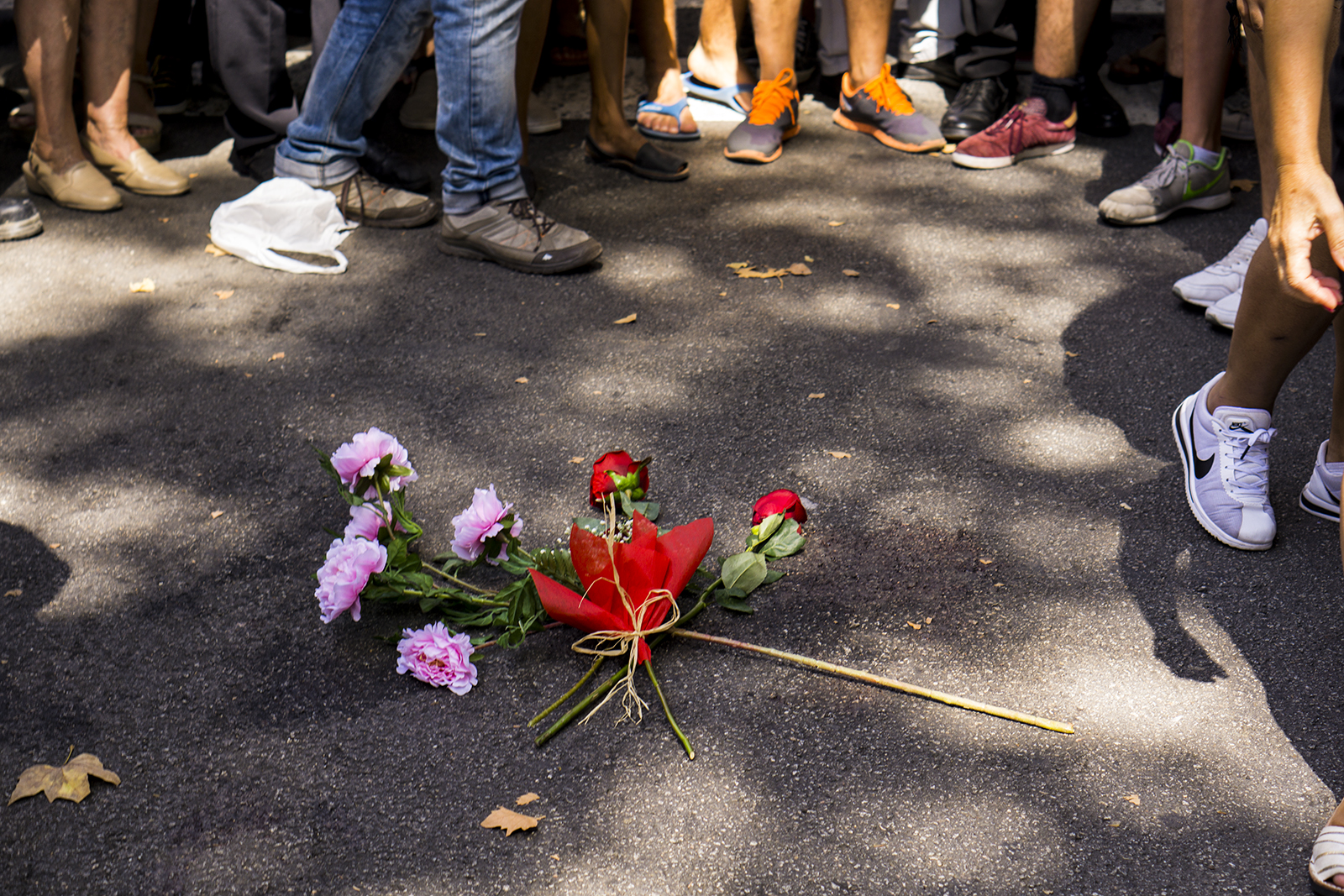 People gather around the roses in Plaza Catalunya and Las Ramblas after a one minute's silence for the victims of the terrorist attack in Barcelona, Spain.