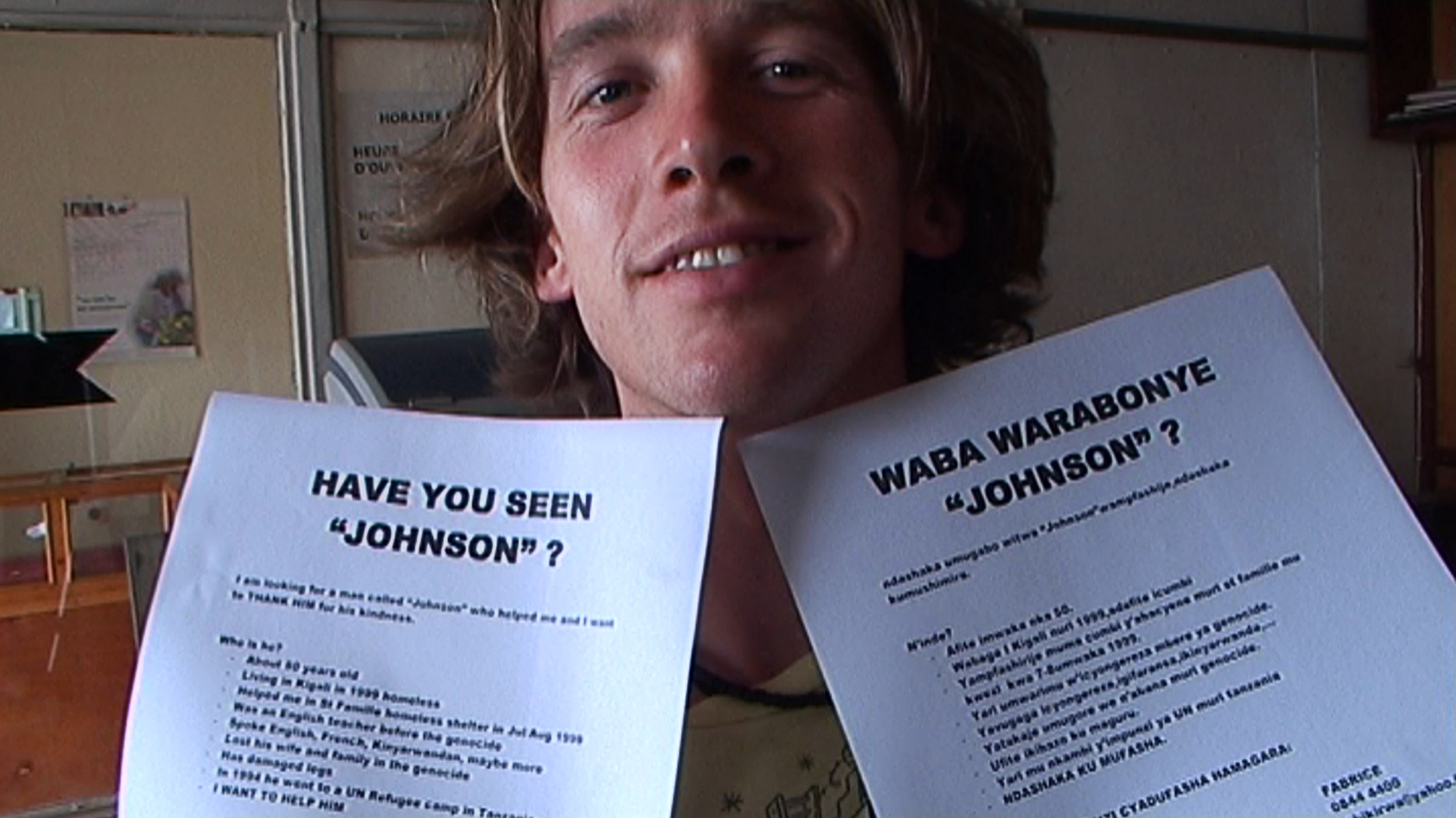 Sven Pannell with posters in Rwanda