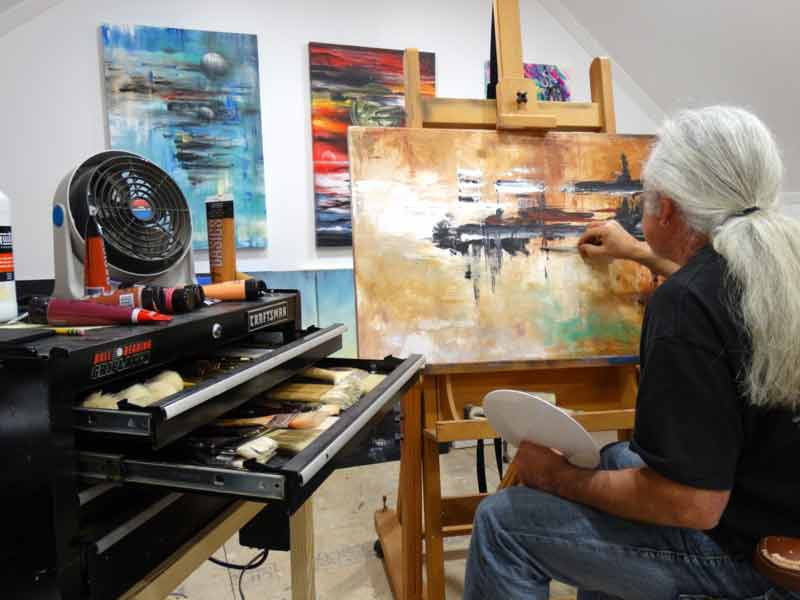 Randall Marmet in his studio with abstract art