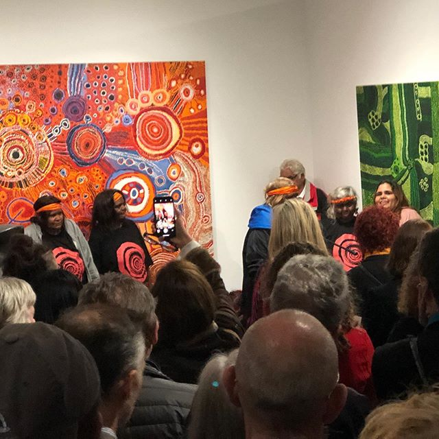 Happy faces and the backs of heads at the opening of a brand new gallery in #Adelaide.  The APY Gallery is set up by a collective of the arts centres across the APY Lands to represent their community in the city.  It's a lovely big space with amazing art and a warm heart.