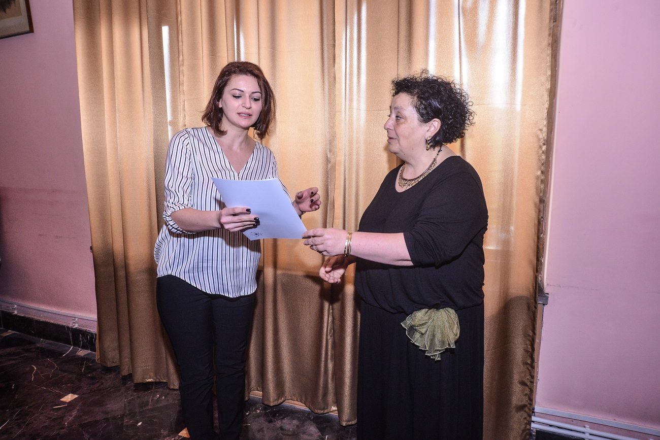 19  Margarit Piliposyan awarding ANSEF 2019 scientits with certificates.JPG
