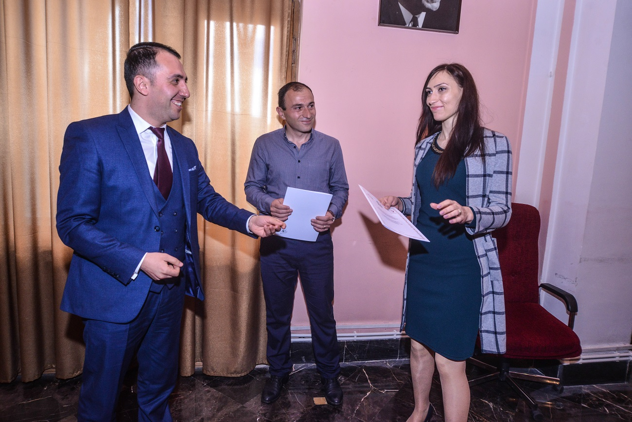 21 Gevorg Vardanyan and Artur Movsisyan  awarding ANSEF 2019 scientits with certificates.JPG