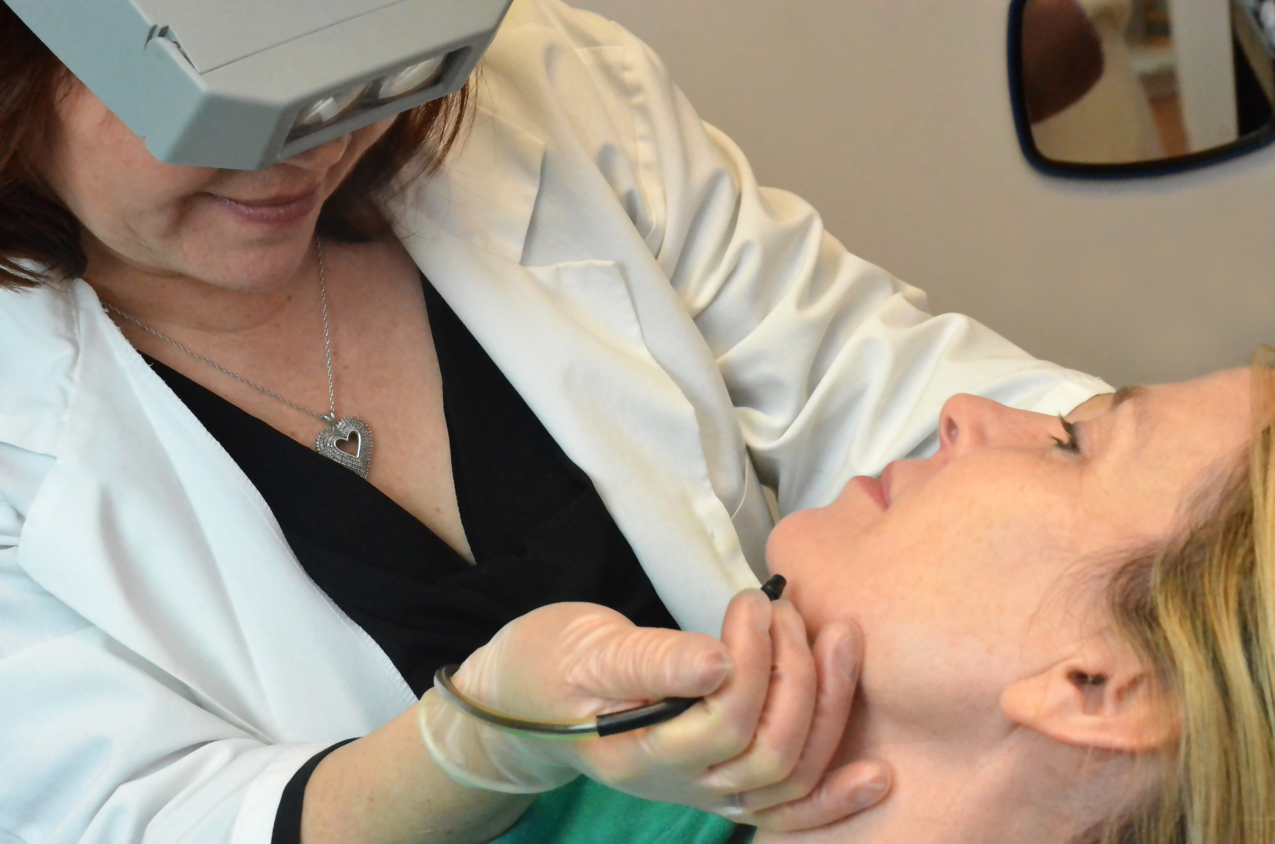 Teresa performs electrolysis on a client