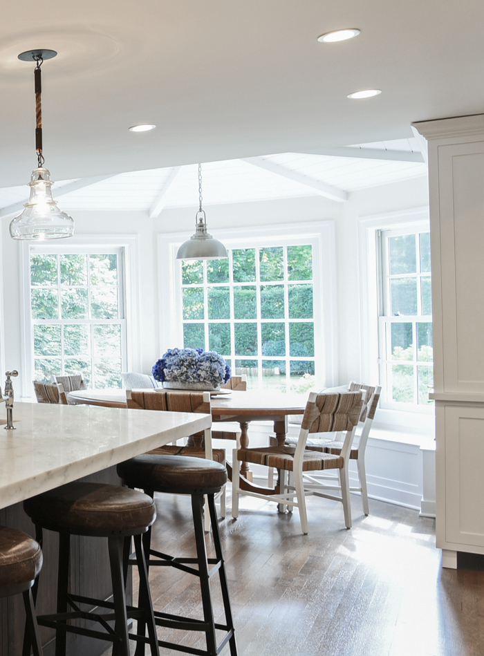 With the client's three kids in mind, this custom-designed breakfast nook melds seamlessly into the outdoors. The ceiling was lifted and vaulted to create a sense of space and whimsy.