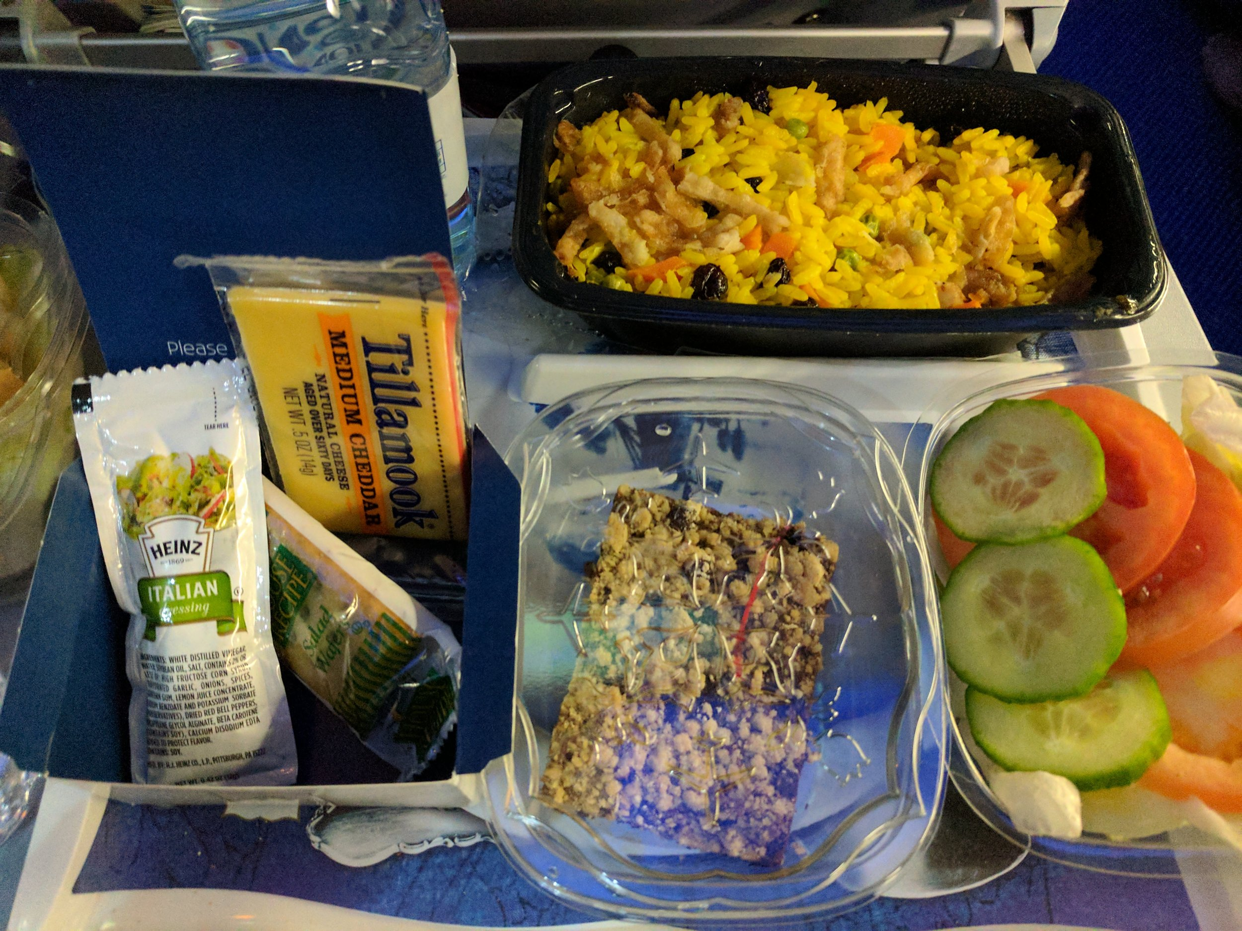 Standard Dinner - Rice stir fry with chicken tenderloin pieces (buried under the rice)Tomato &cucumber salad with standard Italian dressingCrackers with Tillanook cheddar cheeseBaked dessertWater bottle