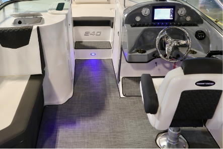 Dual Console - Dual Console offers Portside Domestic head with freshwater 6.5g tank, overhead light and a locking console door. Starboard console is an exciting cockpit offering a full array of electronics, gauges and controls.