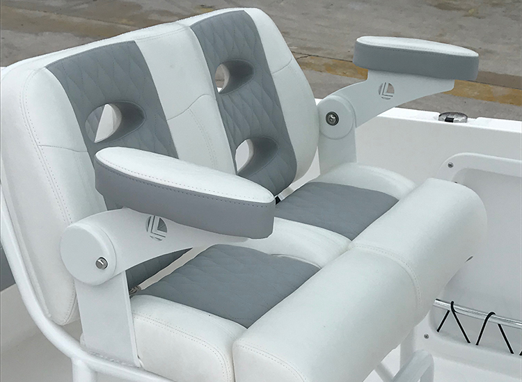 Helm Seating, Llebroc Backrest & Foot Rest - Comfort and function meet when it comes to this super comfy leaning post. It is designed to accommodate two adults and allow you to operate your Twin Vee standing up or in a seated position. Additional features include a footrest and rod holders.