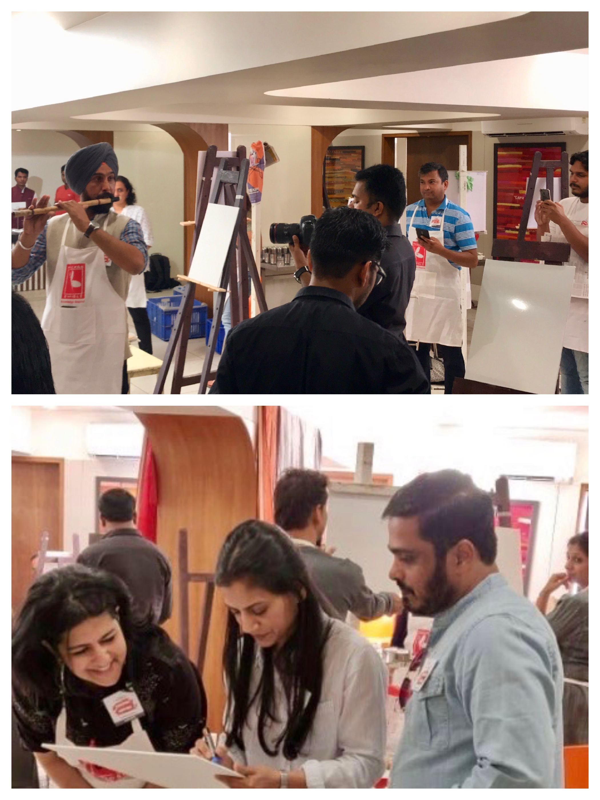 An impromptu flute performance by one of the participants & canvas signing by Pramod &Suchitra as a small keepsake of the workshop while the models & lighting were being setup.