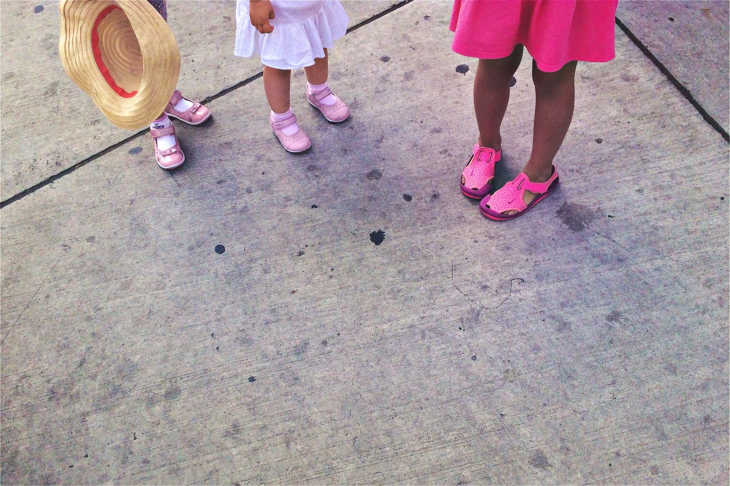 three girls in pink shoes